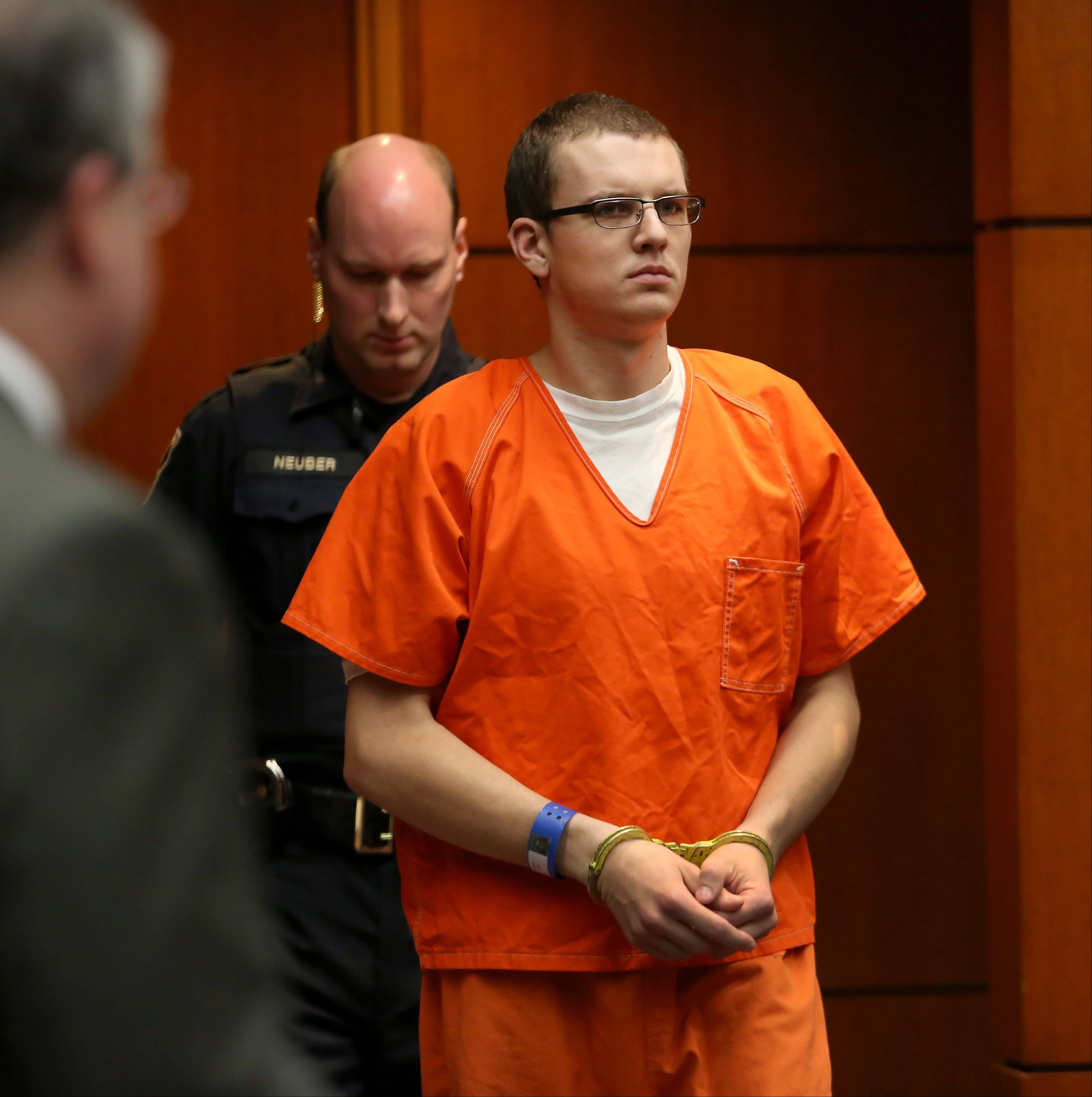 Adam Belmont enters the courtroom Tuesday at the DuPage County courthouse in Wheaton. He pleaded not guilty to first-degree murder and sex assault charges in the Dec. 15 death of his ex-girlfriend, Alyssa Van Meter in her Woodridge apartment. His arraignment is the third in DuPage County to be photographed and video recorded.