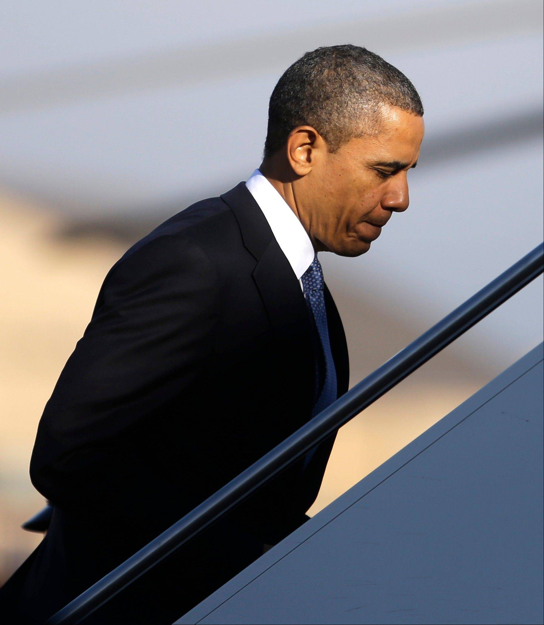 President Barack Obama boards Air Force One, Tuesday, Jan. 29, 2013, in Andrews Air Force Base, Md., en route to Las Vegas to give a speech about immigration.