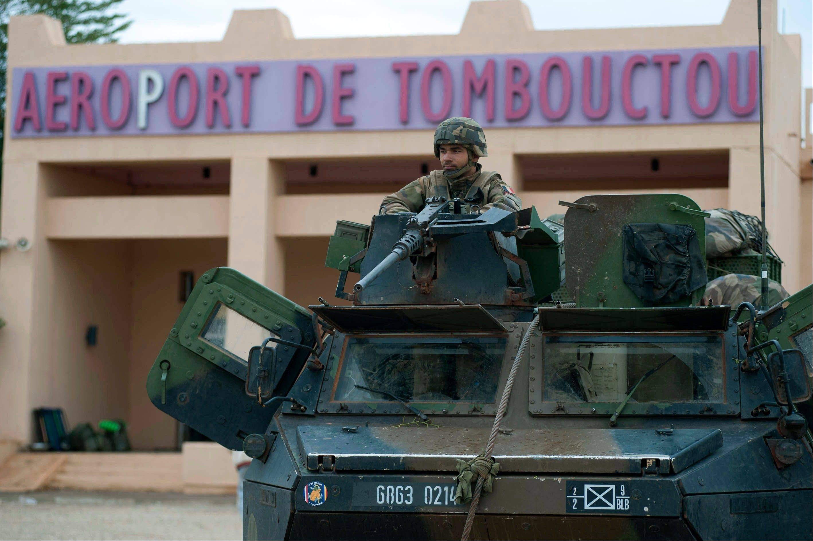 A French soldier guards the Timbuktu airport, in northern Mali. Backed by French helicopters and paratroopers, Malian soldiers entered the fabled city of Timbuktu on Monday after al-Qaida-linked militants who ruled the outpost by fear for nearly 10 months fled into the desert, setting fire to a library that held thousands of manuscripts dating to the Middle Ages.