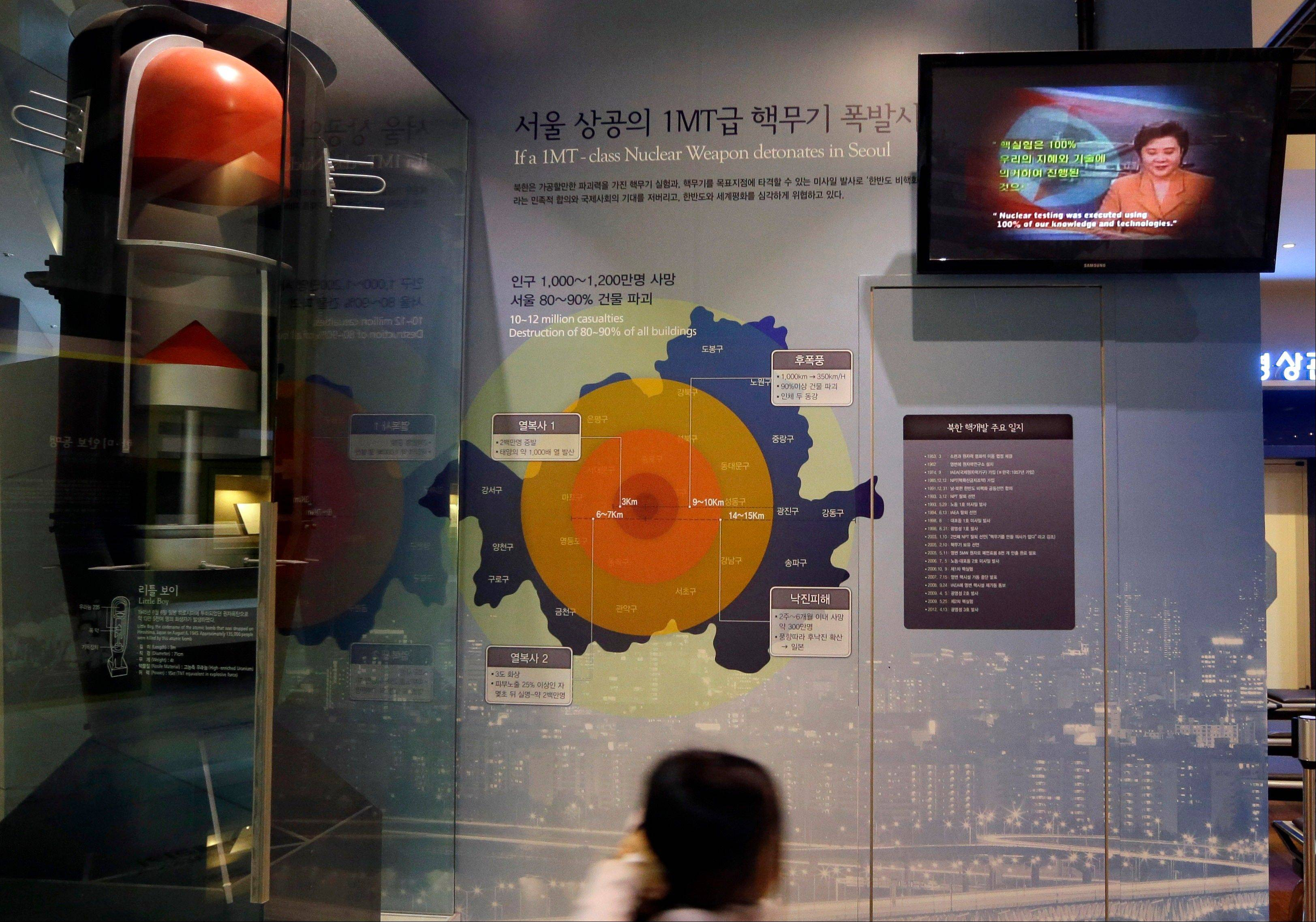 A girl looks at a display on assessment about impact of supposed nuclear attack on Seoul at the Korea War Memorial Museum in Seoul, South Korea, Tuesday, Jan. 29, 2013. North Korea appears all set to detonate an atomic device, but confirming the explosion when it takes place will be virtually impossible for outsiders, specialists said Tuesday.