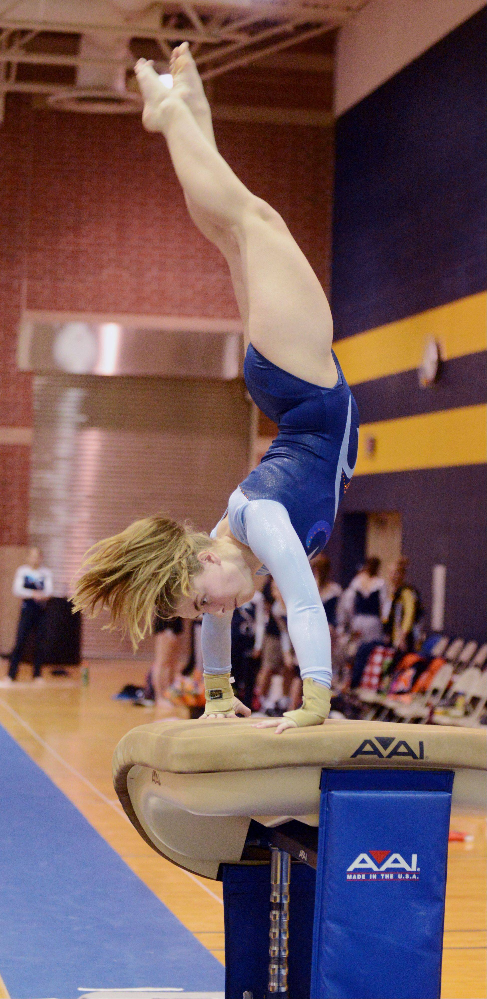 Michaela Robert of Naperville North on the vault during the Neuqua Valley girls regional in Naperville Tuesday.