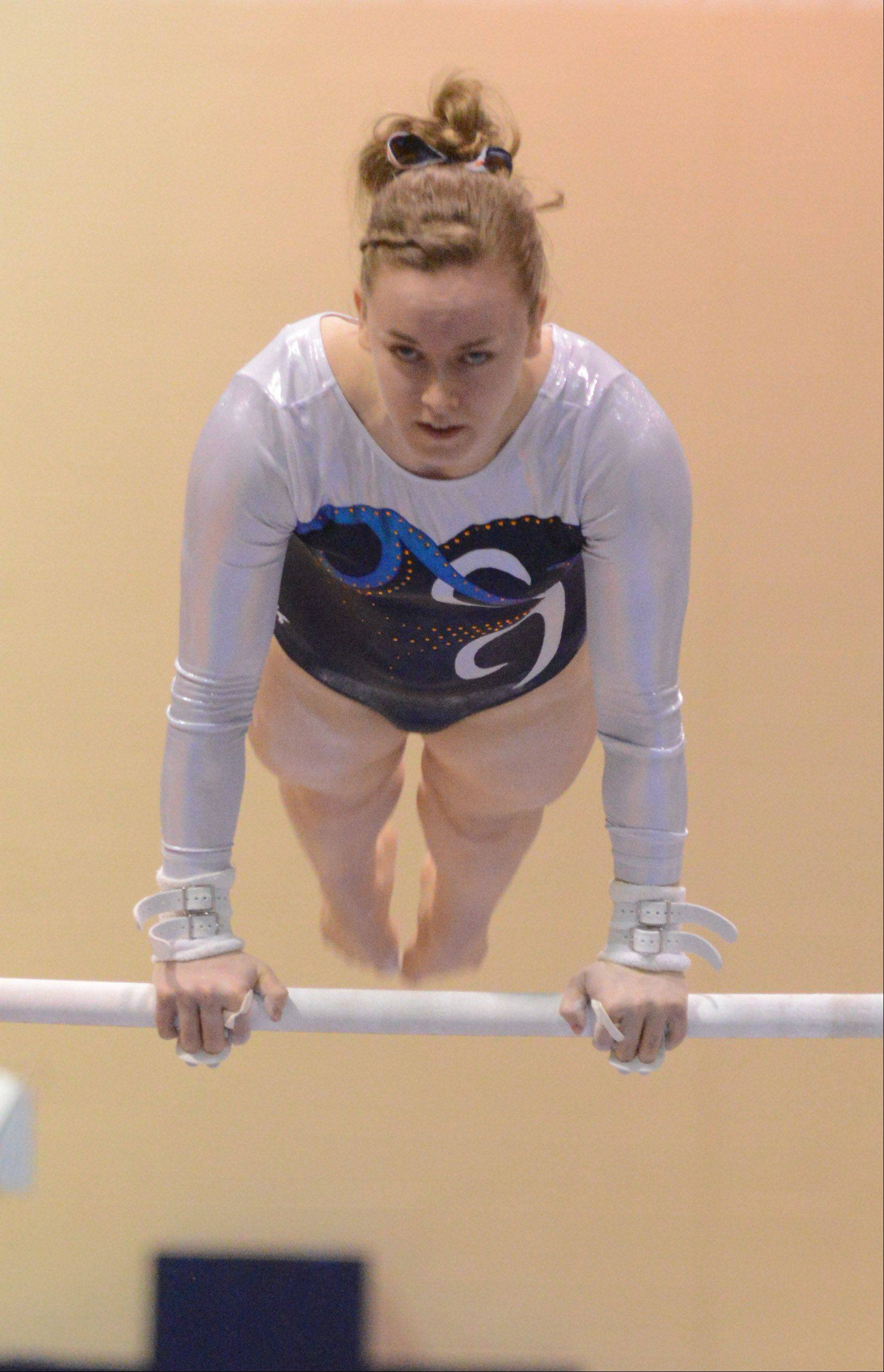 Kaitlyn Daly of Naperville North on the bars during the Neuqua Valley girls regional in Naperville Tuesday.