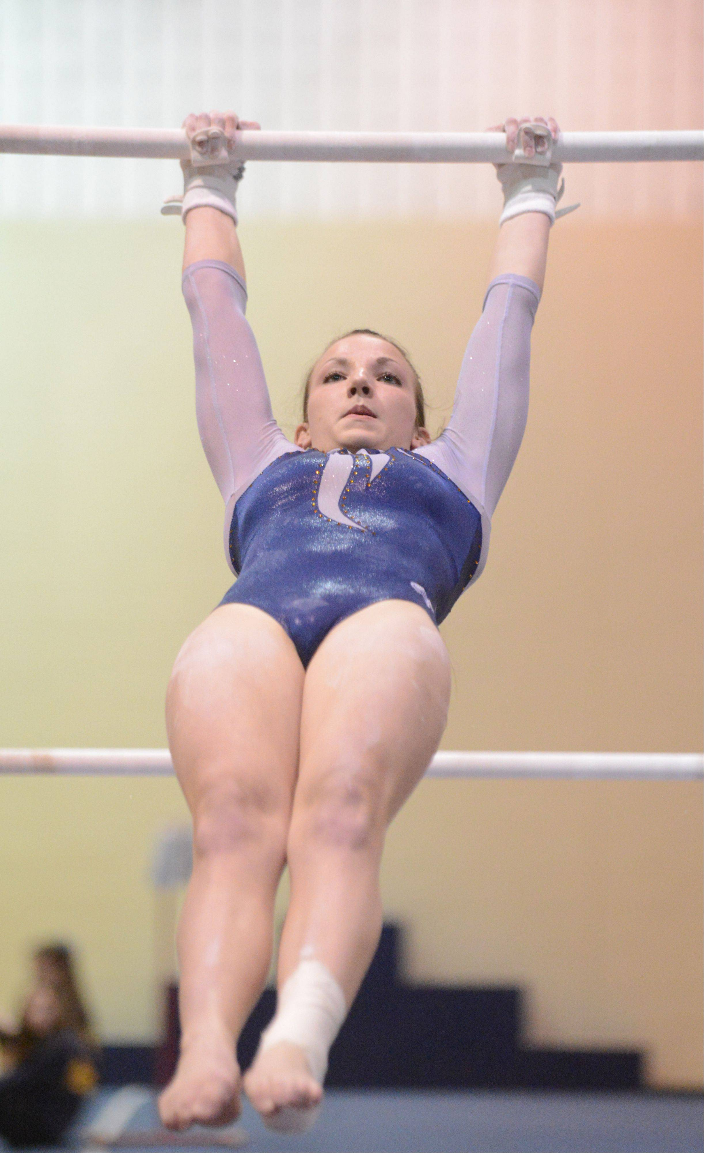 Sara Cushing of Neuqua Valley on the bars during the Neuqua Valley girls regional in Naperville Tuesday.