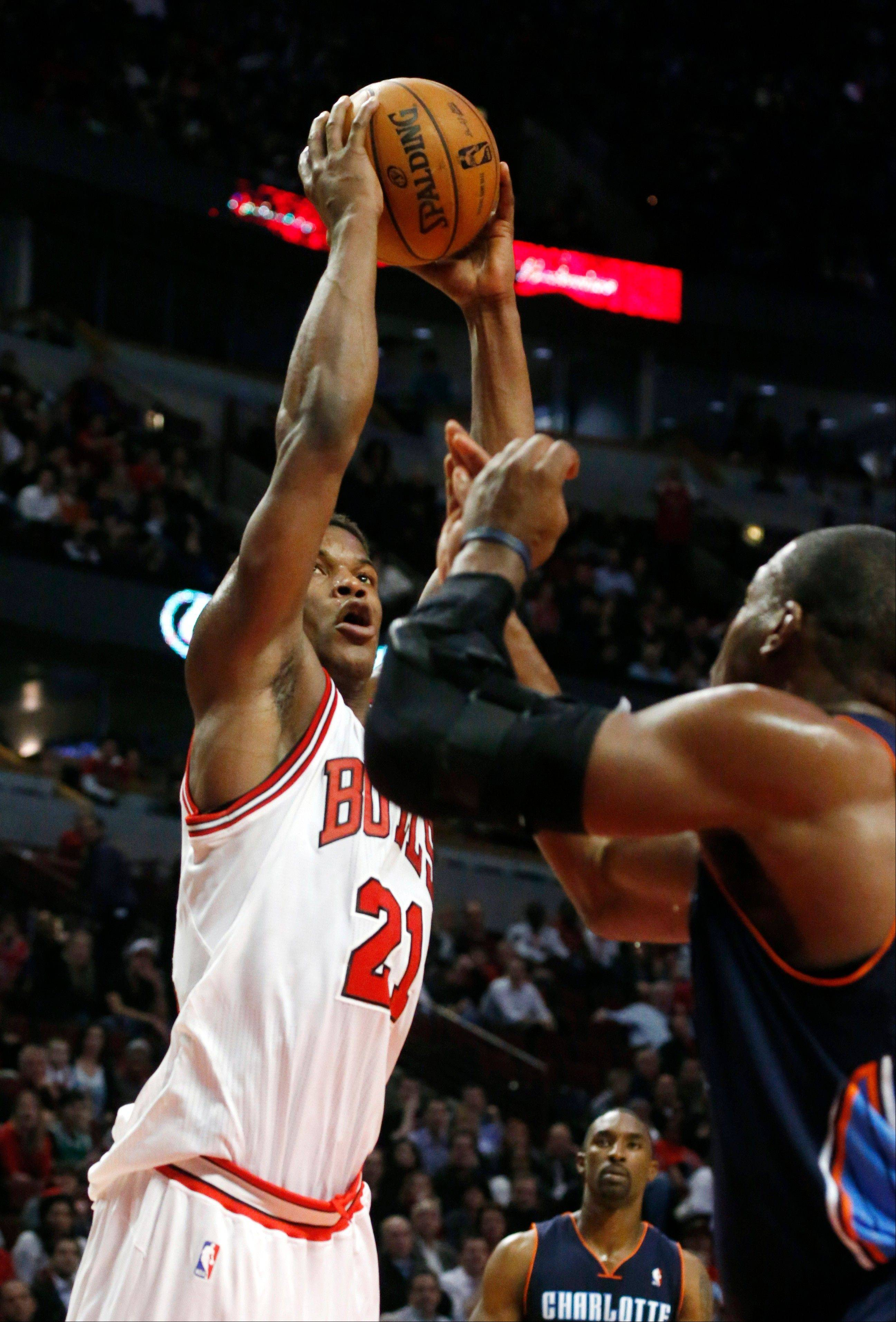 Bulls forward Jimmy Butler shoots over Charlotte's Jeff Adrien during Monday night's victory over the Bobcats.