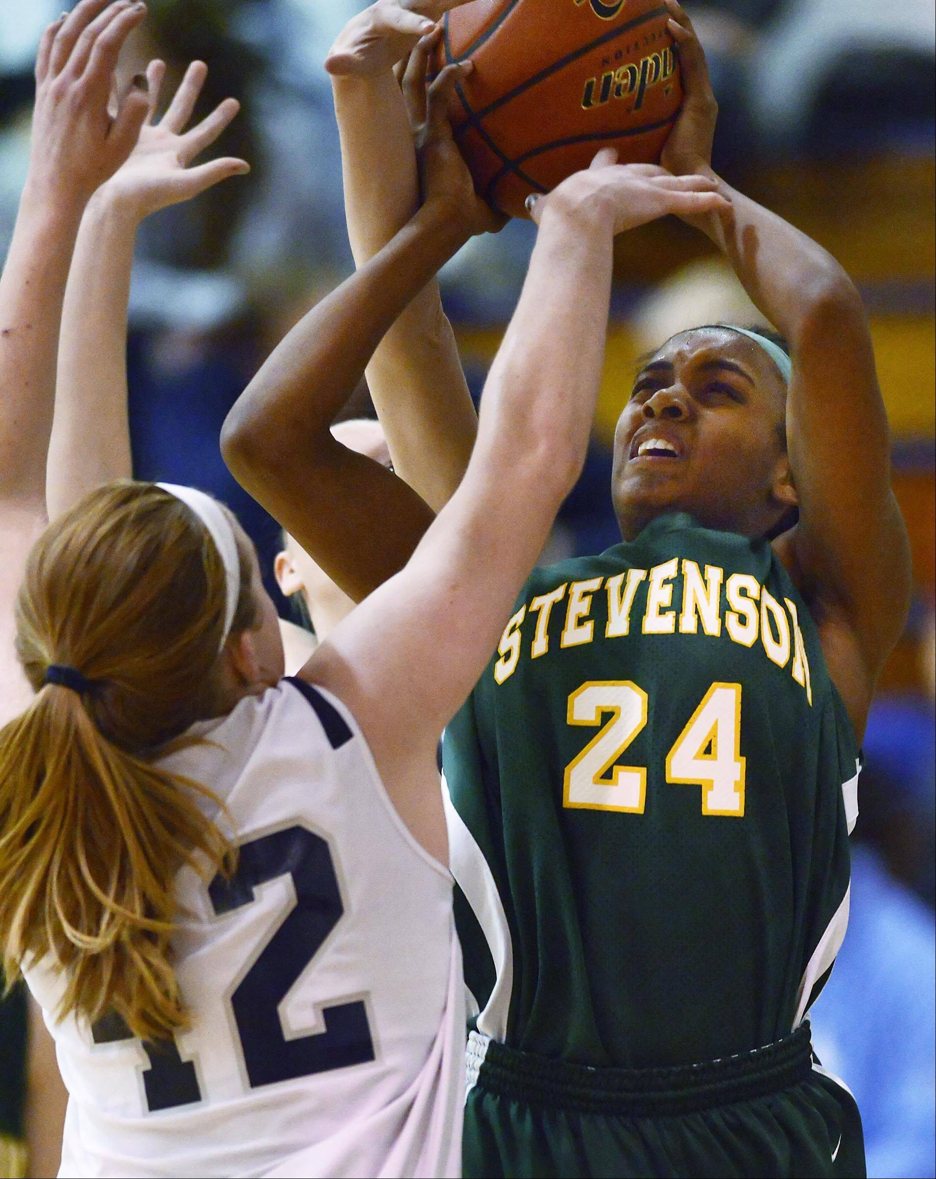 Cary-Grove's Olivia Jakubicek and Morgan Lee defend against Stevenson's Taylor Buford Wednesday in Cary.