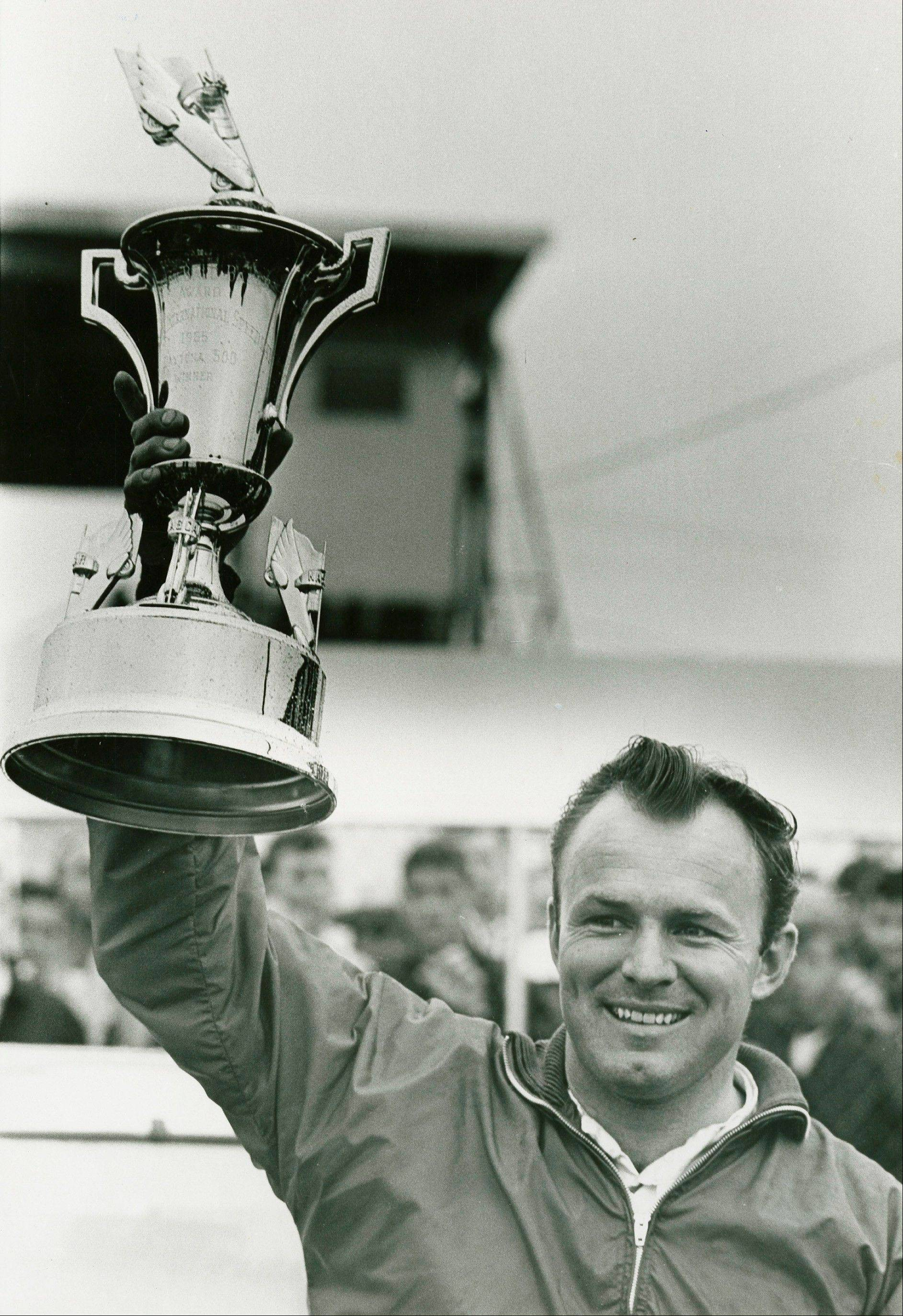 Elmhurst native Fred Lorenzen hoists his trophy after winning the 1965 Daytona 500.