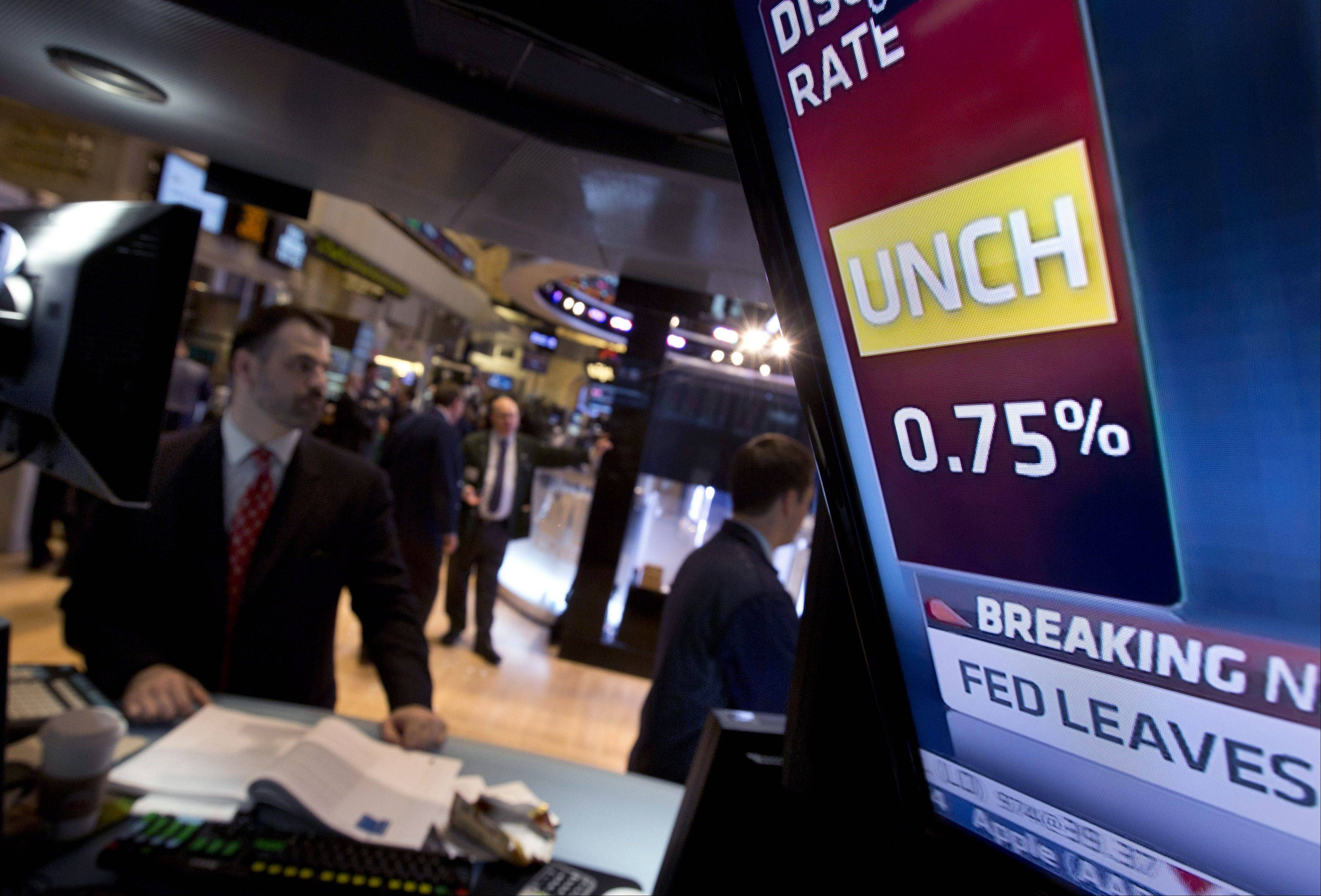 U.S. stocks fell, dragging benchmark indexes from five-year highs, as the Federal Reserve said it will maintain its program to buy securities after the economy unexpectedly shrank in the fourth quarter.