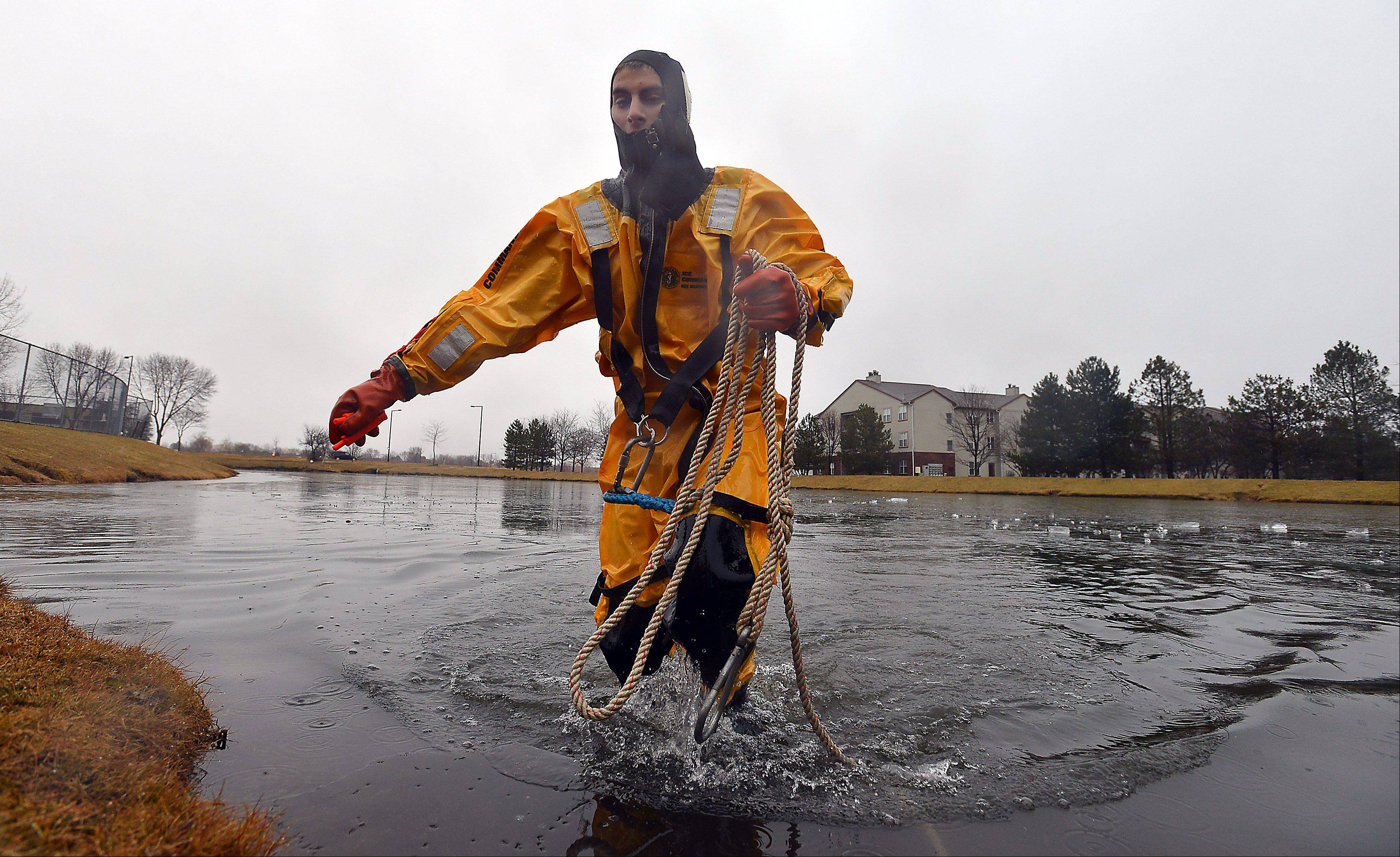 Paid on Call rookie firefighter Kyle Schrems from Lincolnshire made his first ice rescue braving the 30 degree plus temperature at the retention pond located next to the Combined Area Fire Training Facility in Buffalo Grove on Wednesday.