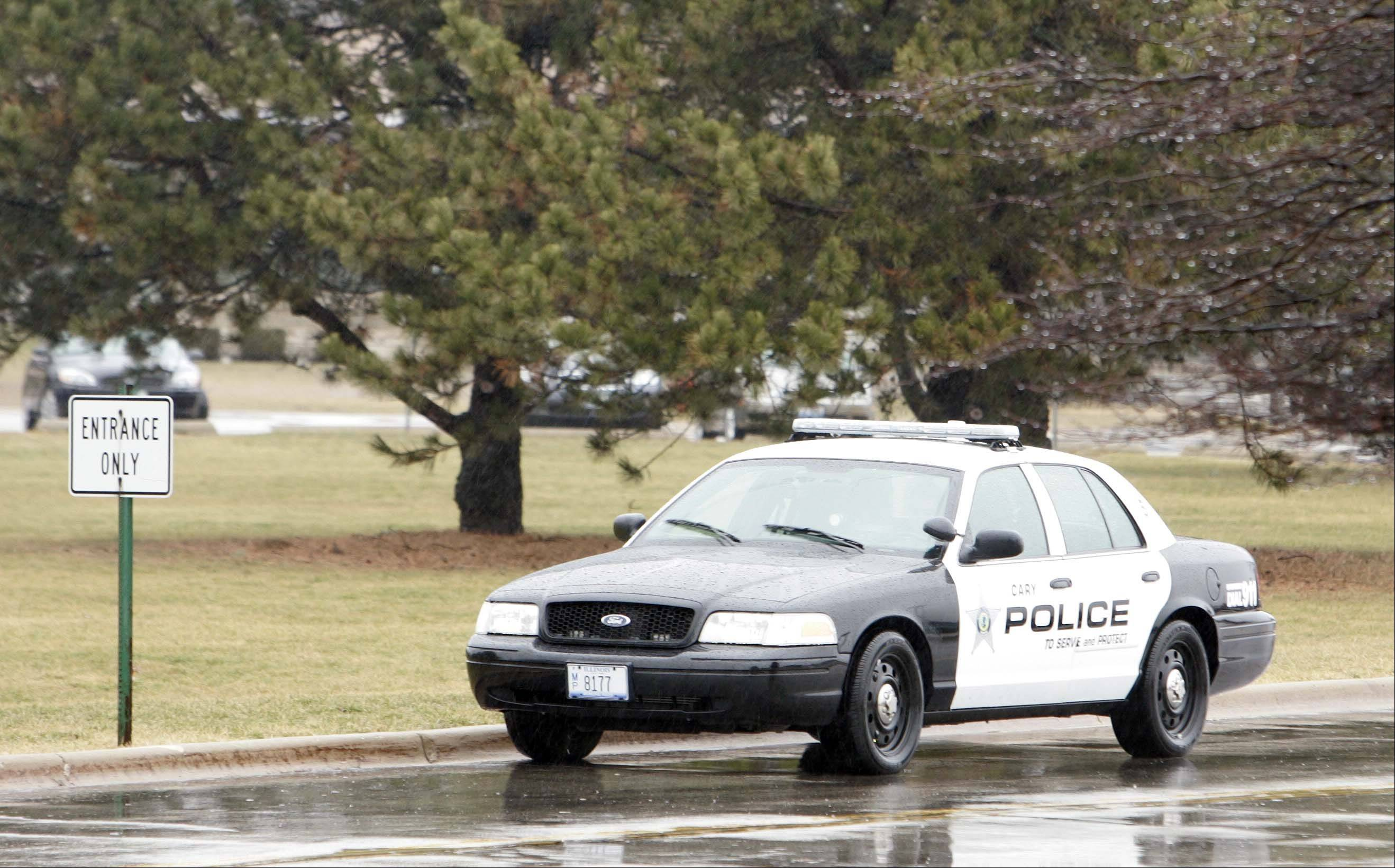 A Cary police squad car secures entry to the Cary-Grove High School campus Wednesday morning as a code red �lockdown� safety drill involving simulated gunshots took place.
