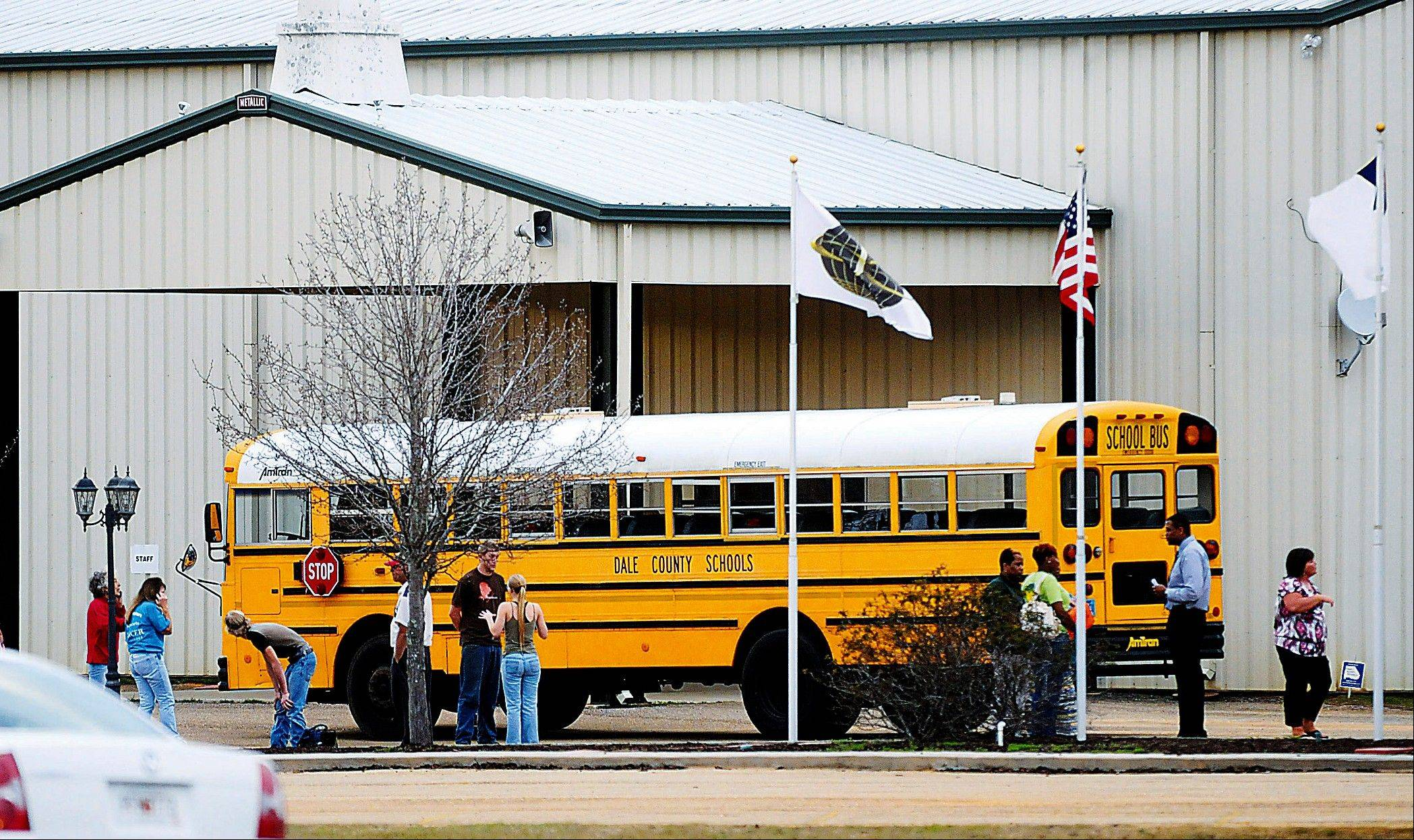 Police, SWAT teams and negotiators were at a rural property where a man was believed to be holed up in a homemade bunker Wednesday, HAN 30, 2013 after fatally shooting the driver of a school bus and fleeing with a 6-year-old child passenger, authorities said. The man boarded the stopped school bus in the town of Midland City on Tuesday afternoon and shot the driver when he refused to let the child off the bus. The bus driver died.