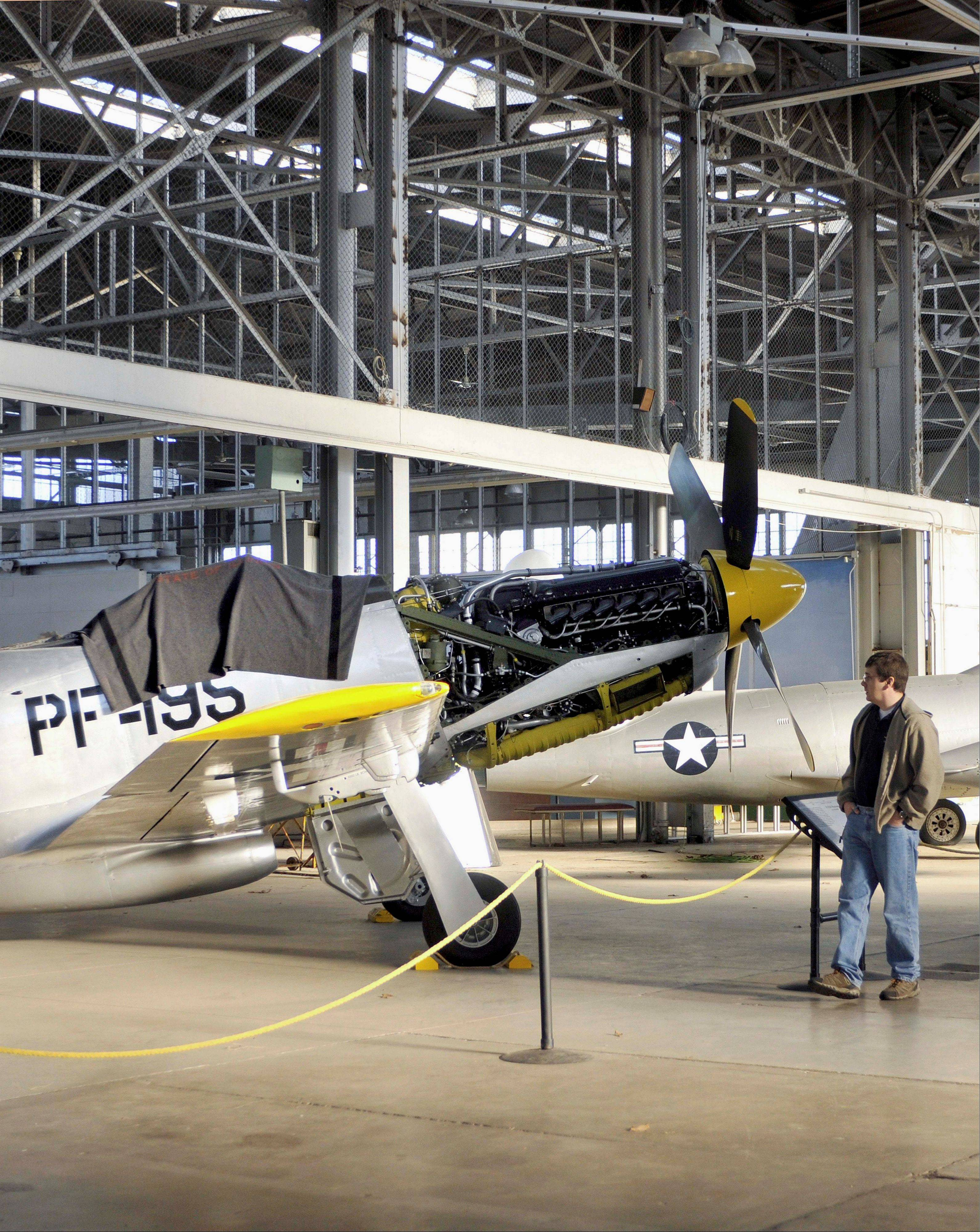 Mark Hanson, curator of the Chanute Air Museum in Rantoul looks over a P-51H Mustang, which is currently being restored at the museum's hangar.