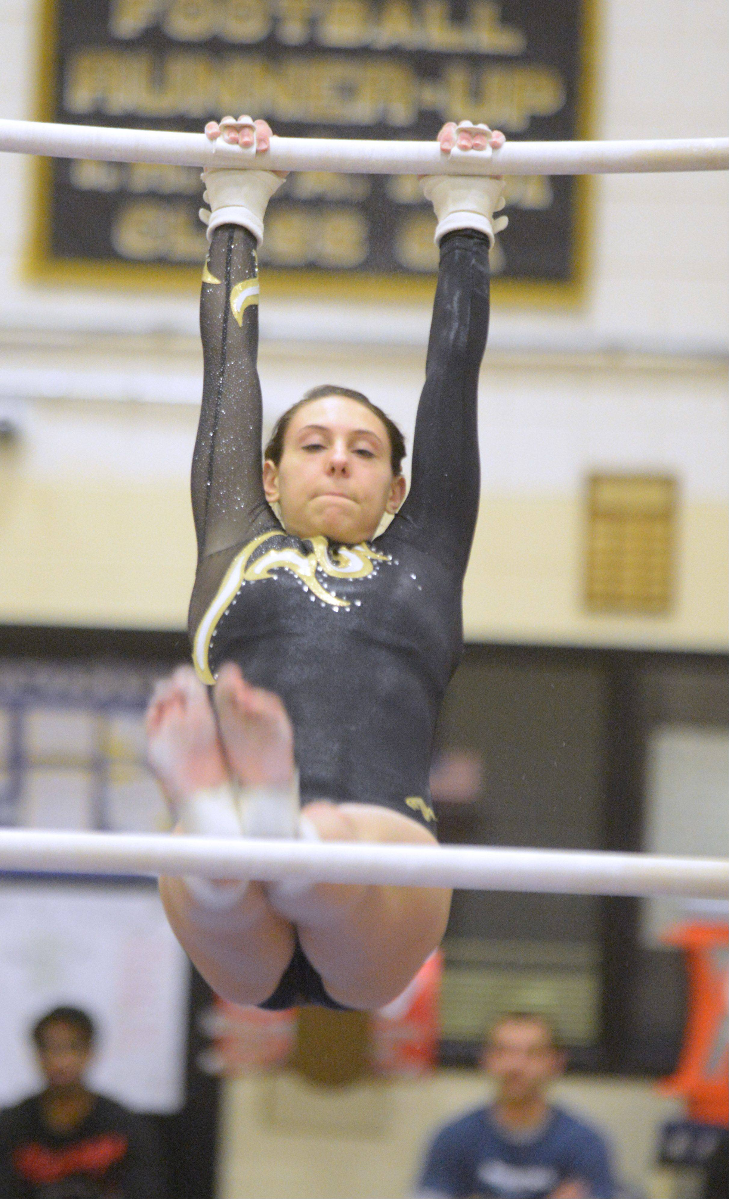 Mariah Matesi of Glenbard North one the bars during the Glenbard North girls gymnastics regional Wednesday in Carol Stream.