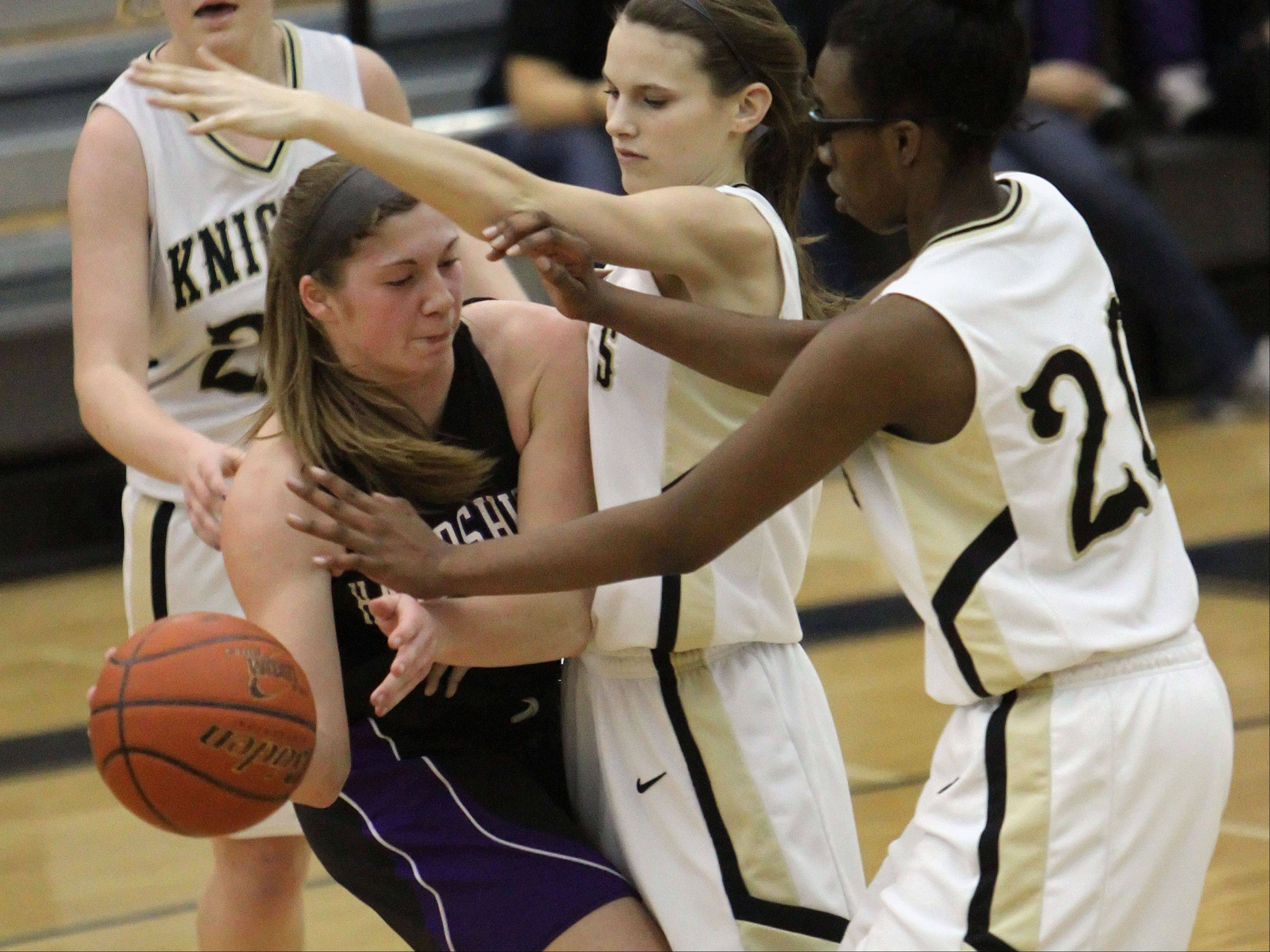 Grayslake North�s Maggie Fish and Brittany Thibeaux, right, guard Hampshire�s Jen Dumoulin.