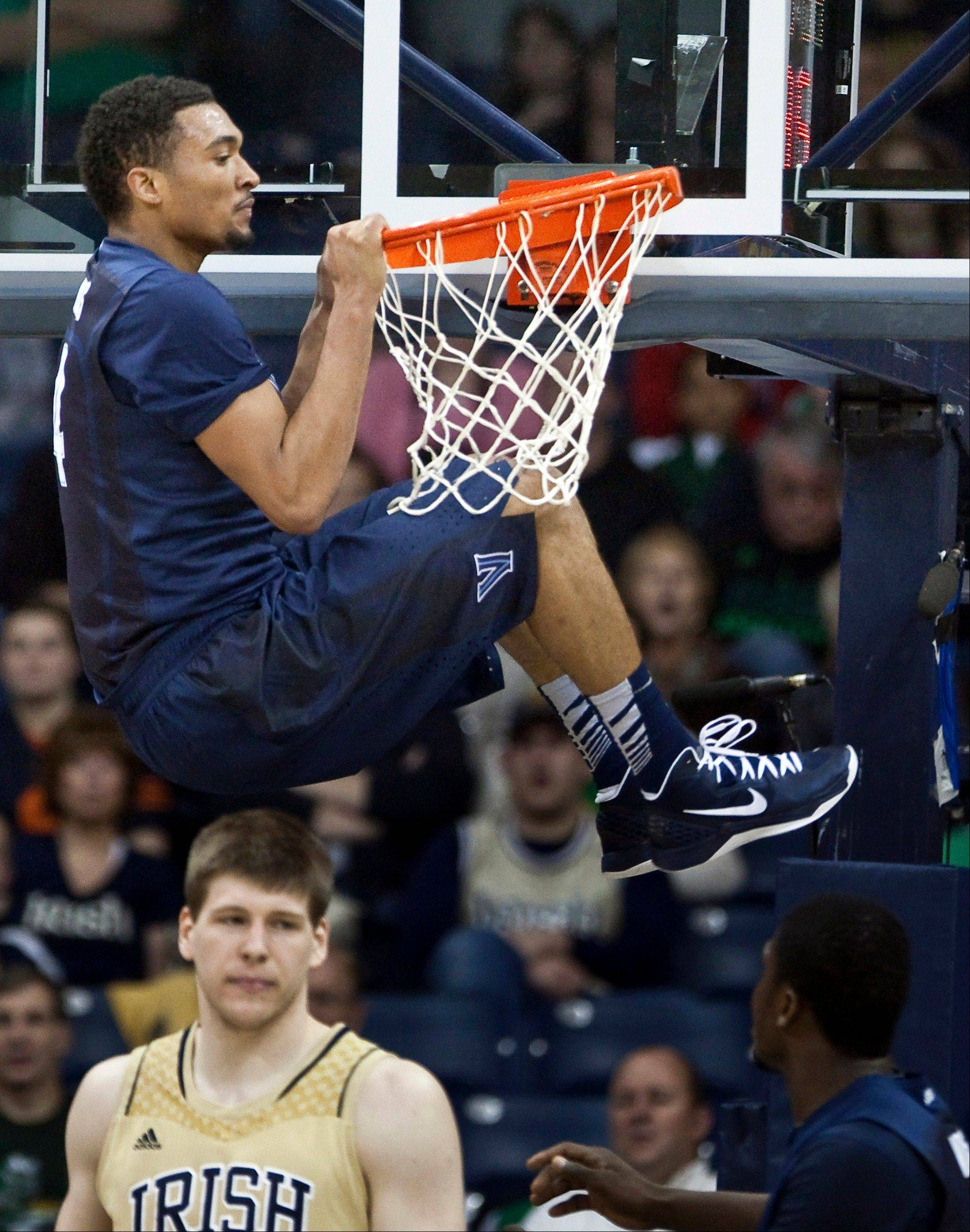 Villanova�s Darrun Hilliard hangs on the rim following a dunk against Notre Dame Wednesday night in South Bend. Notre Dame beat Villa Nova 65-60.