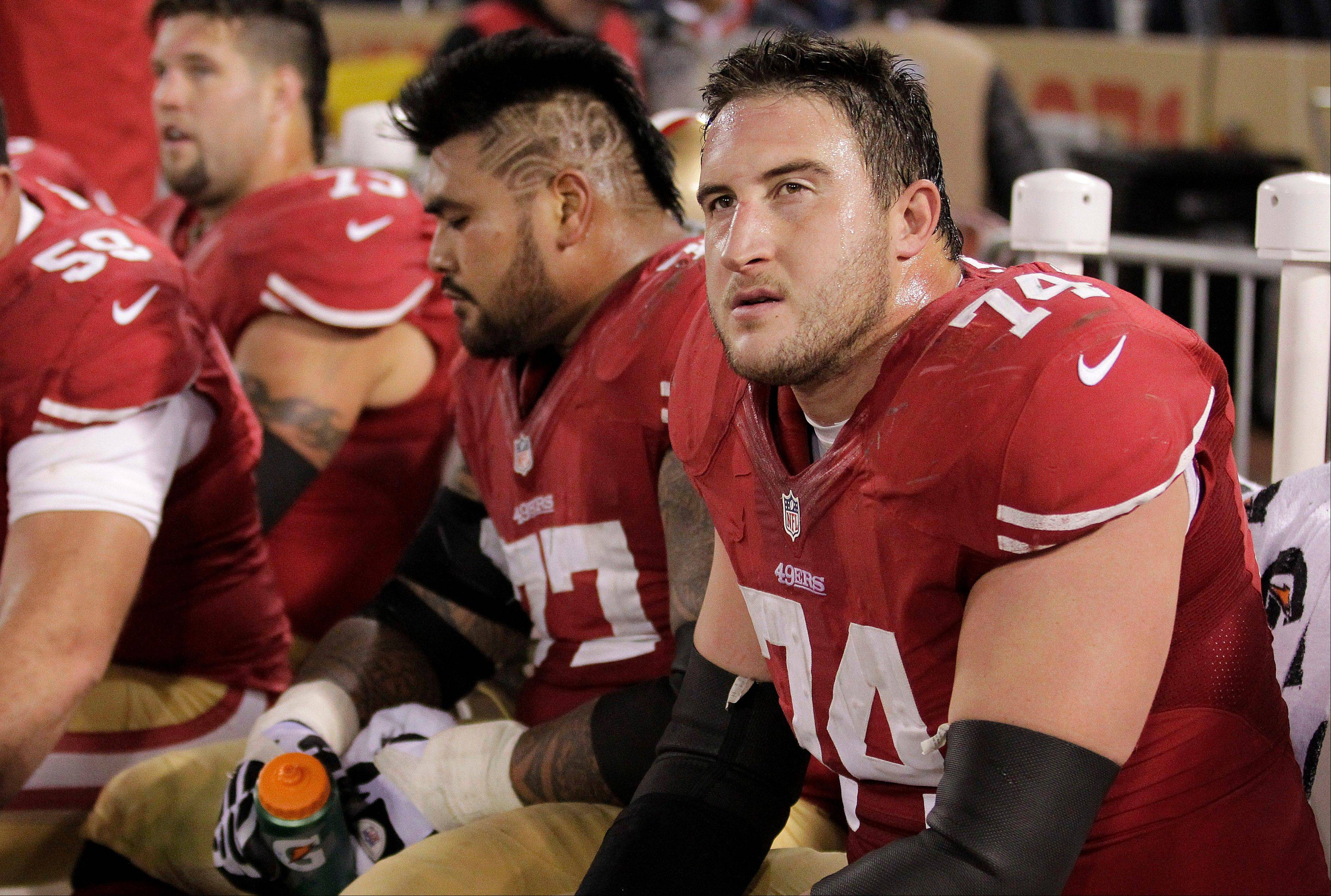 The San Francisco 49ers start three first-round draft picks on their offensive line, including tackle Joe Staley (74) and guard Mike Iupati (77).