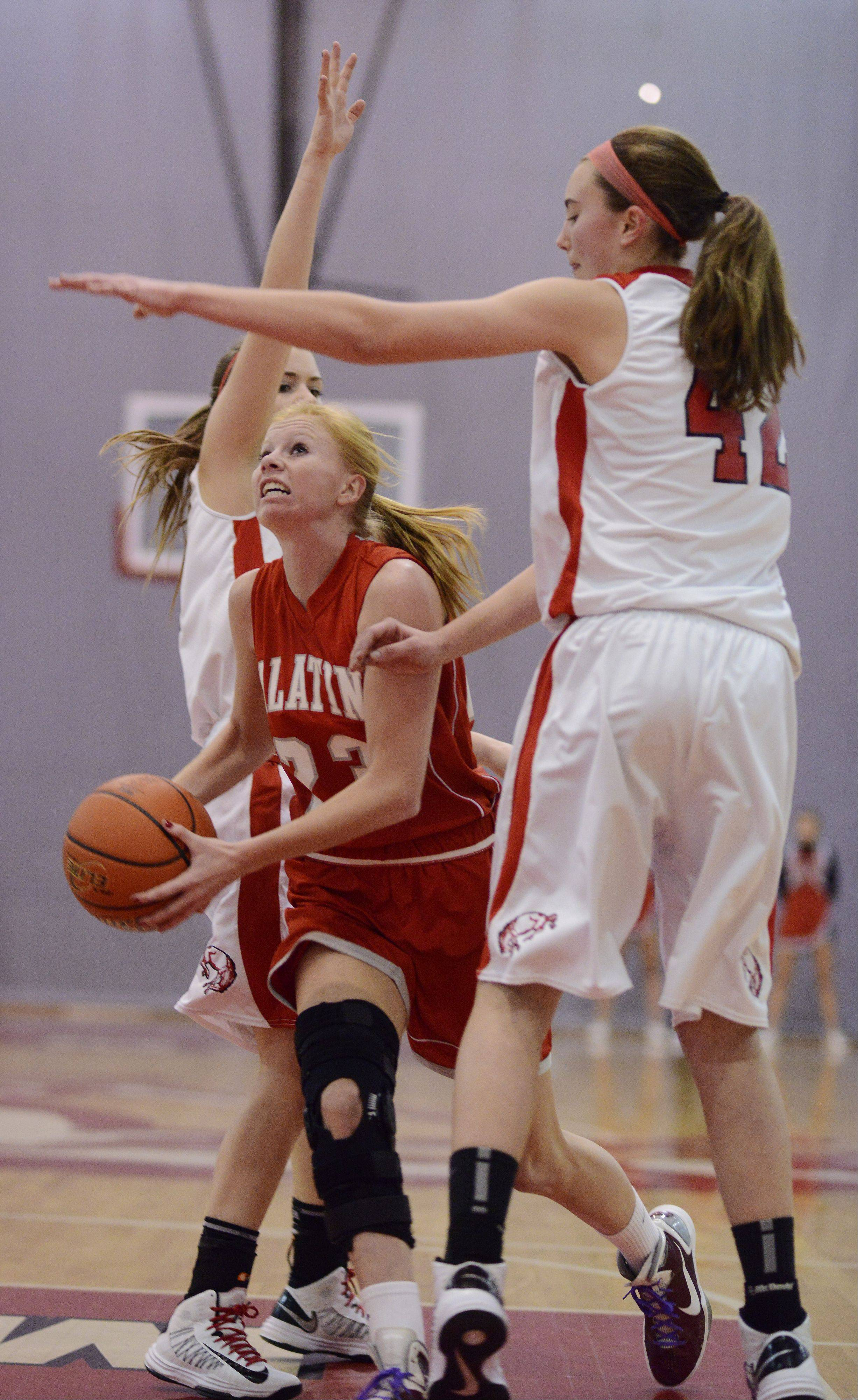 Palatine�s McKenzie Wiedemann tries to get past Barrington�s Megan Talbot earlier this season. Palatine has been bamed the Chicago Sky Girls High Schooll Basketball Team of the Week.