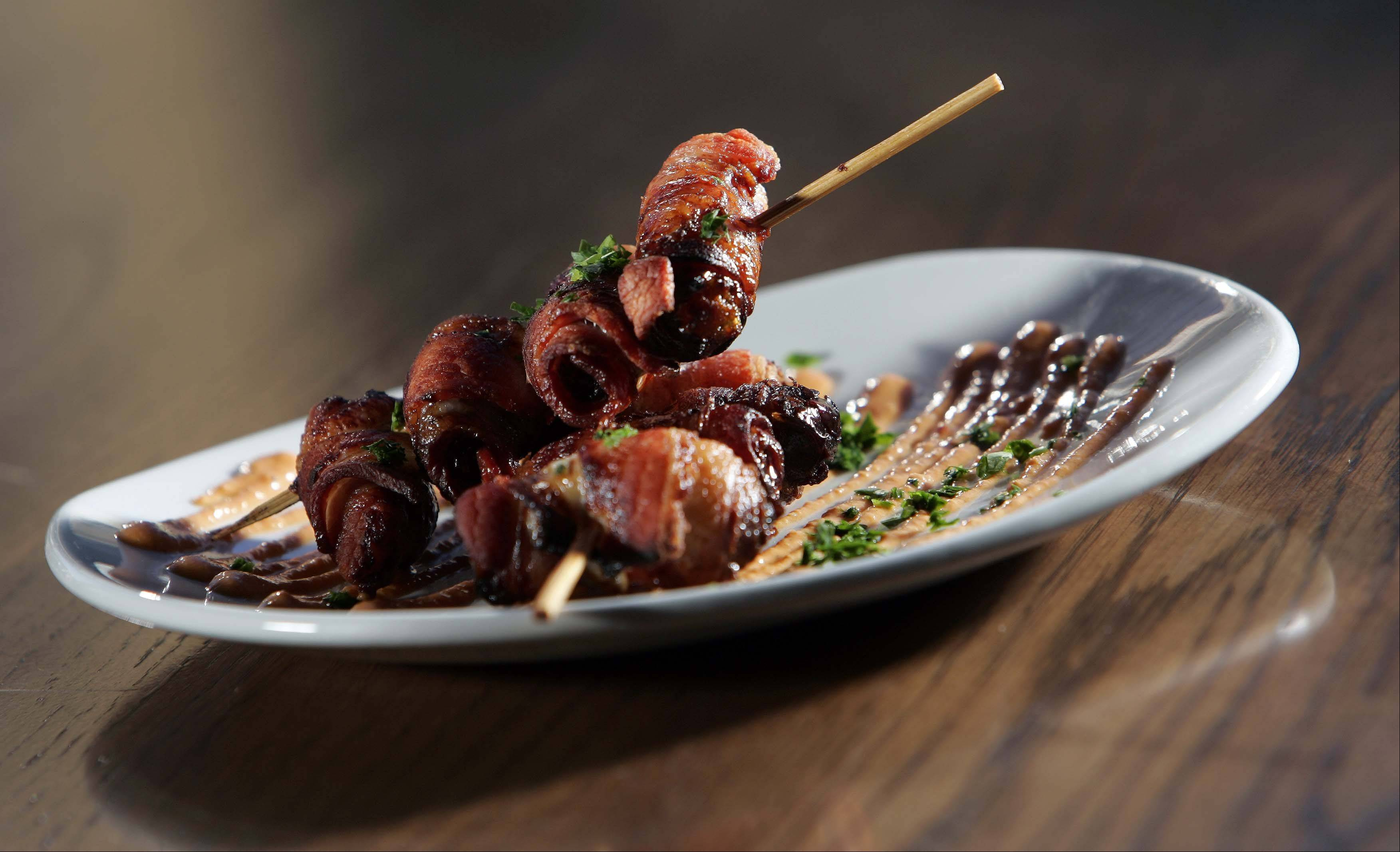 Bacon wrapped dates are a popular starter at Wild Monk in St. Charles.