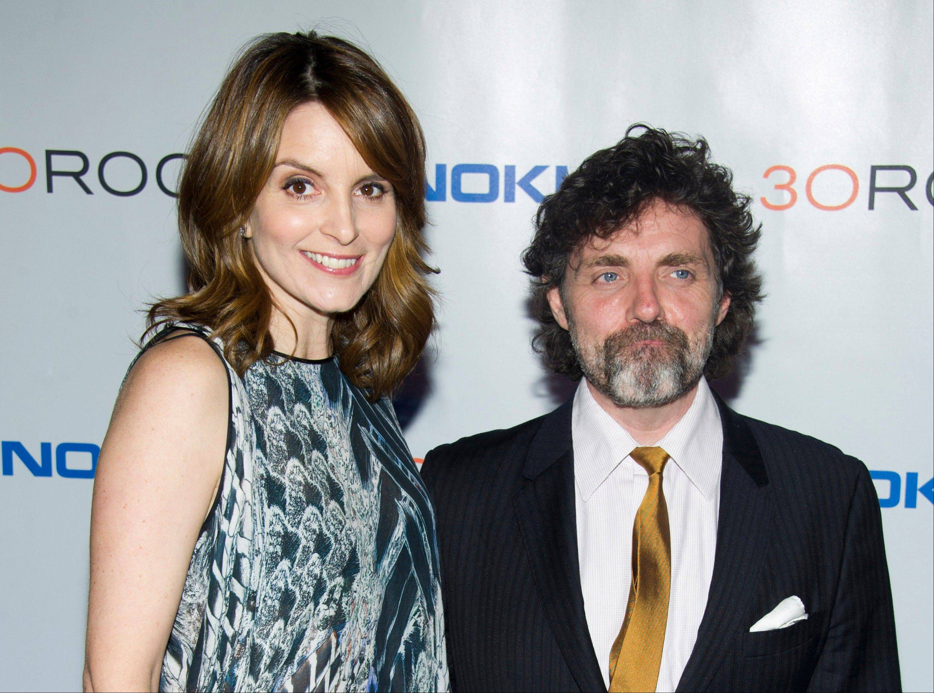 "Tina Fey, left, and her husband Jeff Richmond at the ""30 Rock"" farewell wrap party in New York. Richmond is executive producer and the composer and arranger for the show."