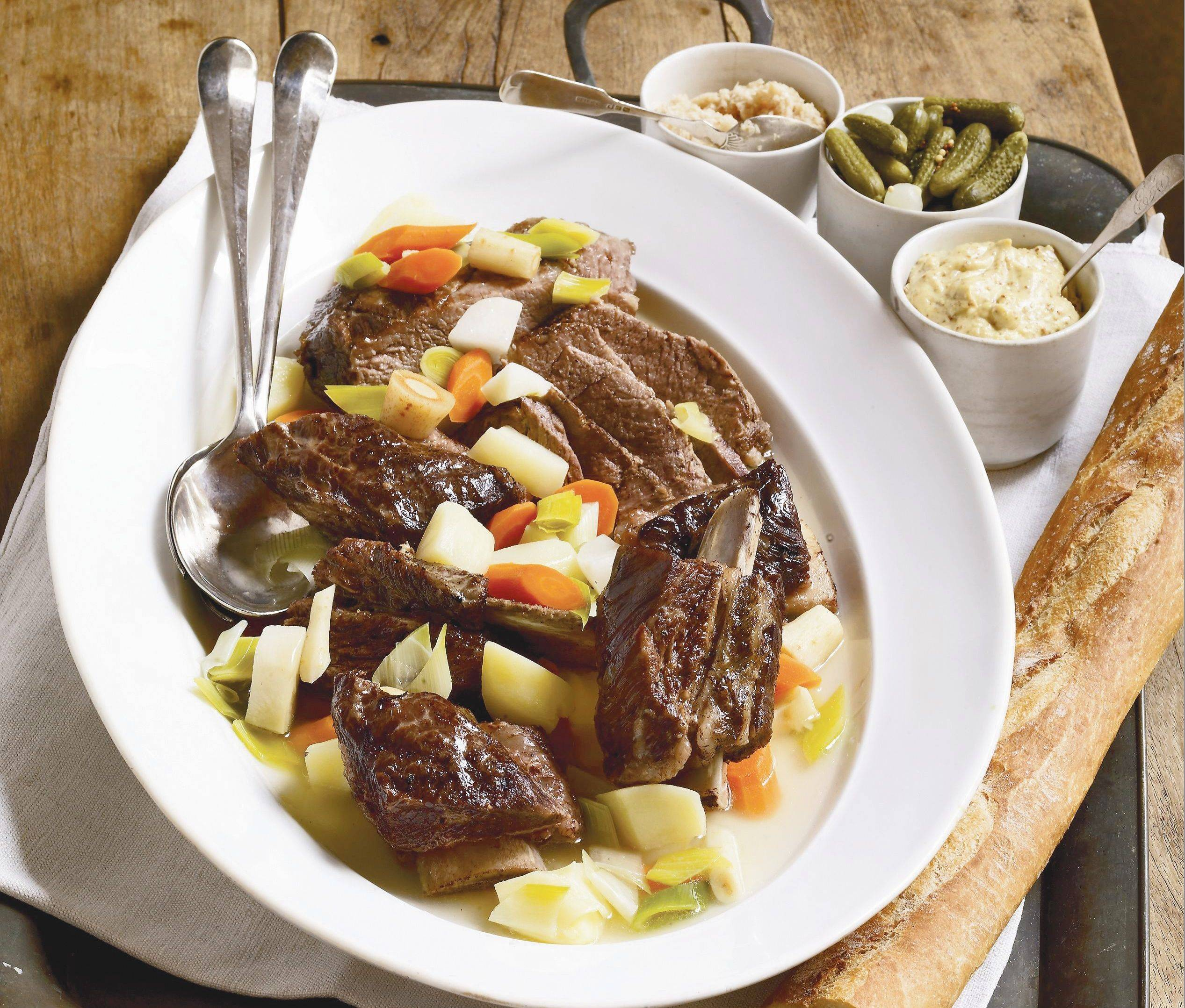 "Come in from the cold to a classic French country dish updated in ""The Mediterranean Slow Cooker"" by Michele Scicolone."