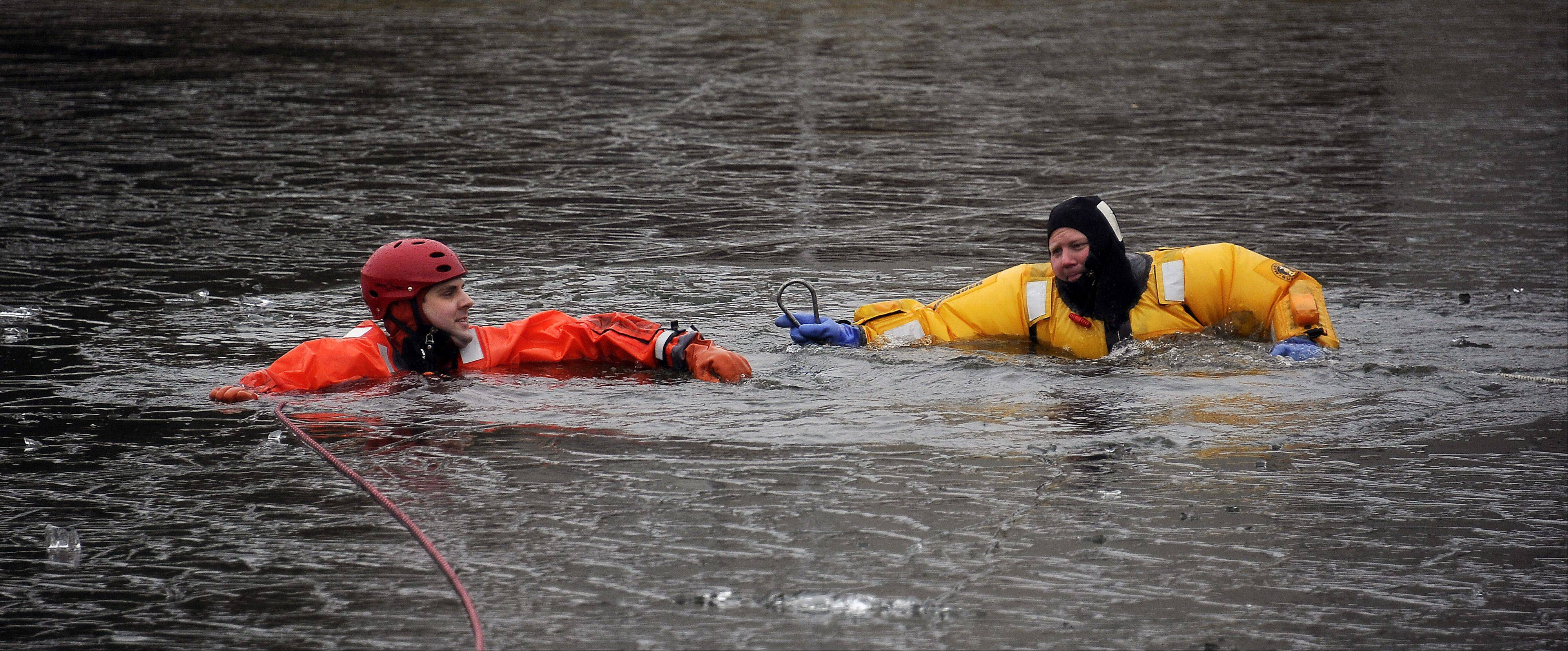 Firefighter/paramedic Jason Stockton from Lincolnshire dons a dry suit braving the 30 degree water to rescue victim Nick Otto from Buffalo Grove Fire Department during their ice rescue drills. The training took place at the retention pond located next to the Combined Area Fire Training Facility in Buffalo Grove on Wednesday.