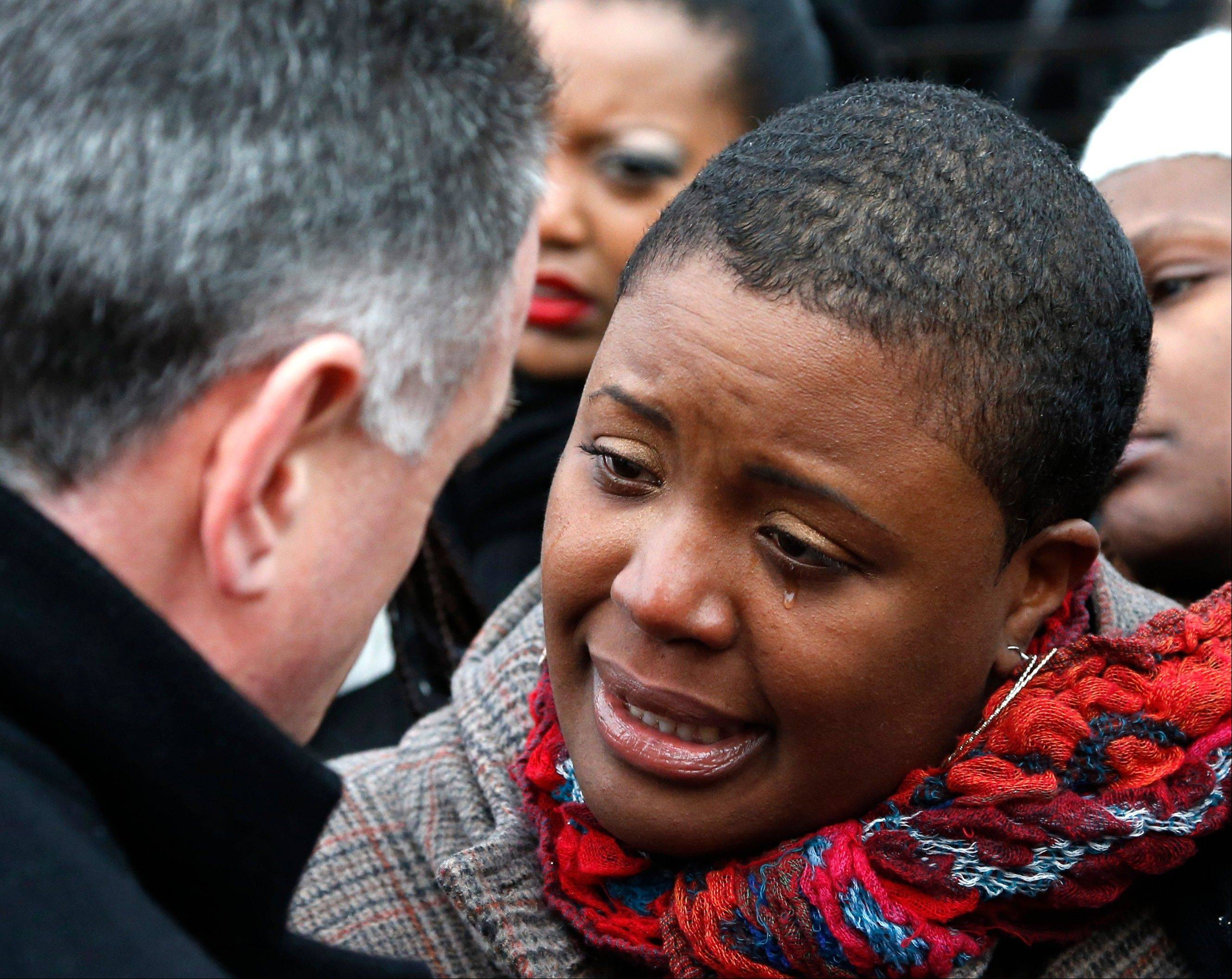 Cleopatra Pendelton cries as she talks with Chicago Police Superintendent Garry McCarthy before a news conference Wednesday seeking help from the public in solving her daughter's murder. Hadiya Pendelton, 15, who had performed in President Barack Obama's inauguration festivities, was killed in a Chicago park as she talked with friends on Tuesday.