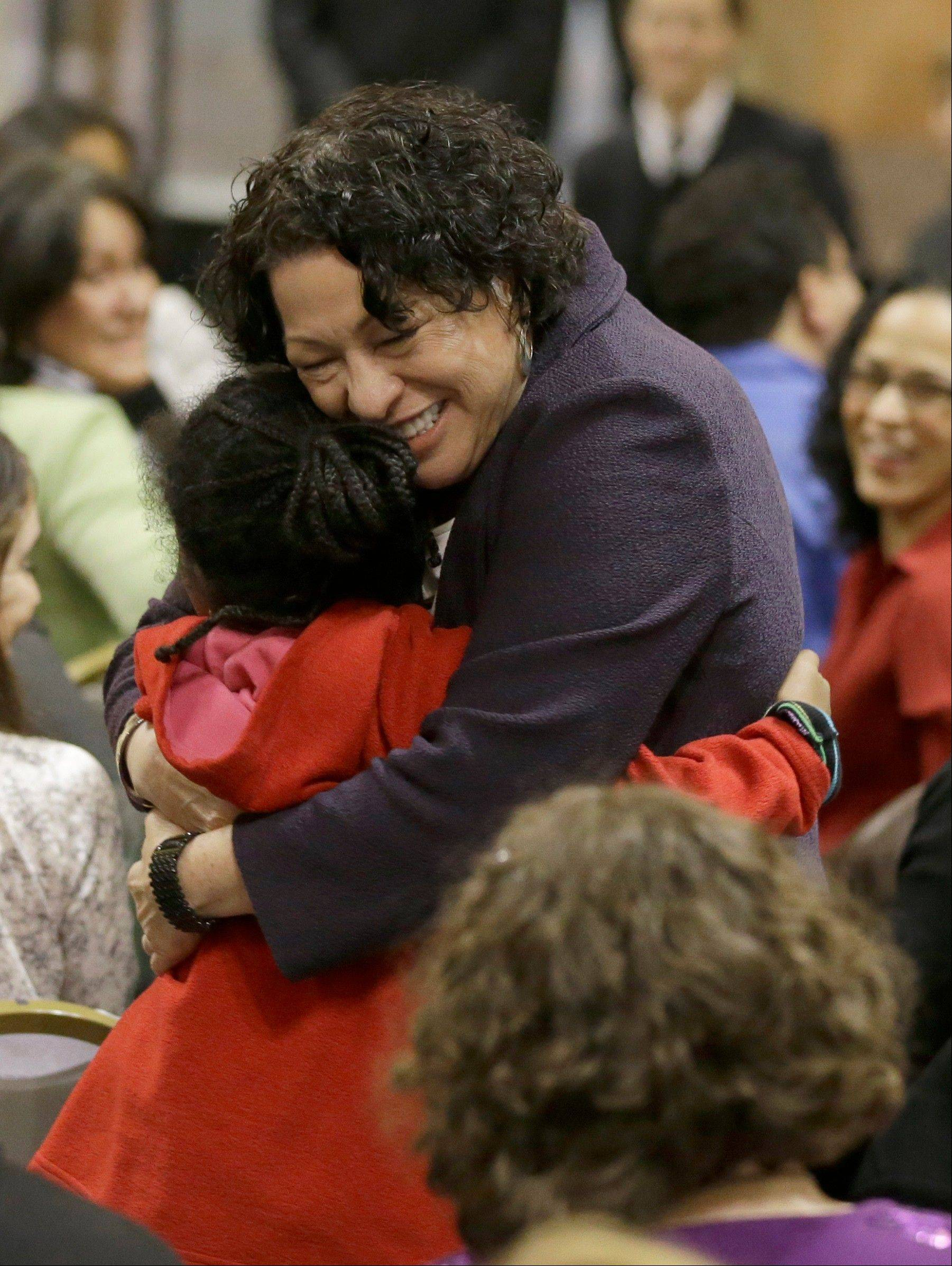 U.S. Supreme Court Justice Sonia Sotomayor hugs Tabbie Major, 7, during a question-and-answer session Wednesday at the Chicago Public Library.