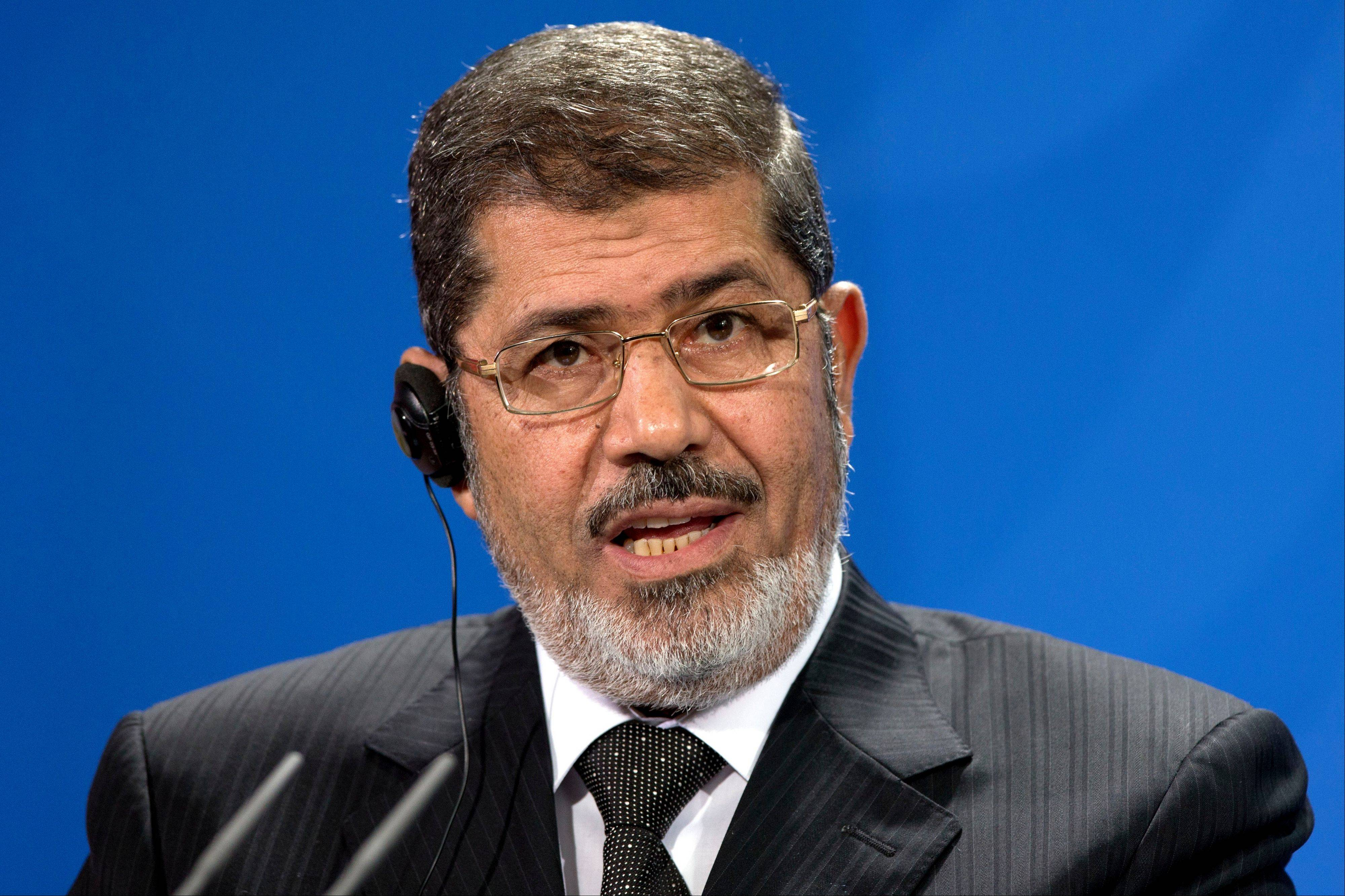 President of Egypt Mohammed Morsi, addresses the media during a joint news conference with German Chancellor Angela Merkel, unseen, after a meeting at the chancellery in Berlin, Germany, Wednesday, Jan. 30, 2013.
