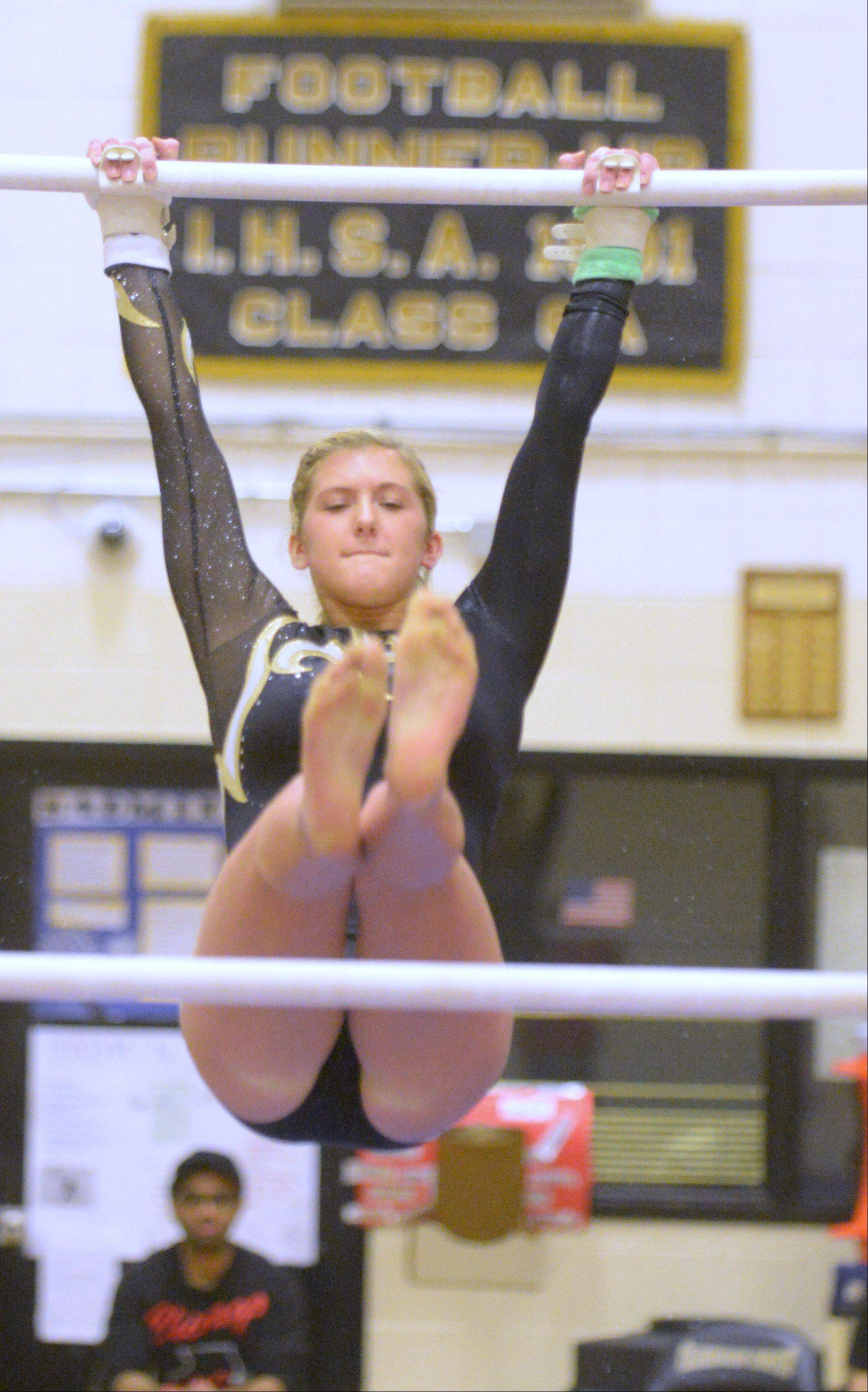 Shayna Bott of Glenbard North on the bars during the Glenbard North girls gymnastics regional Wednesday in Carol Stream.