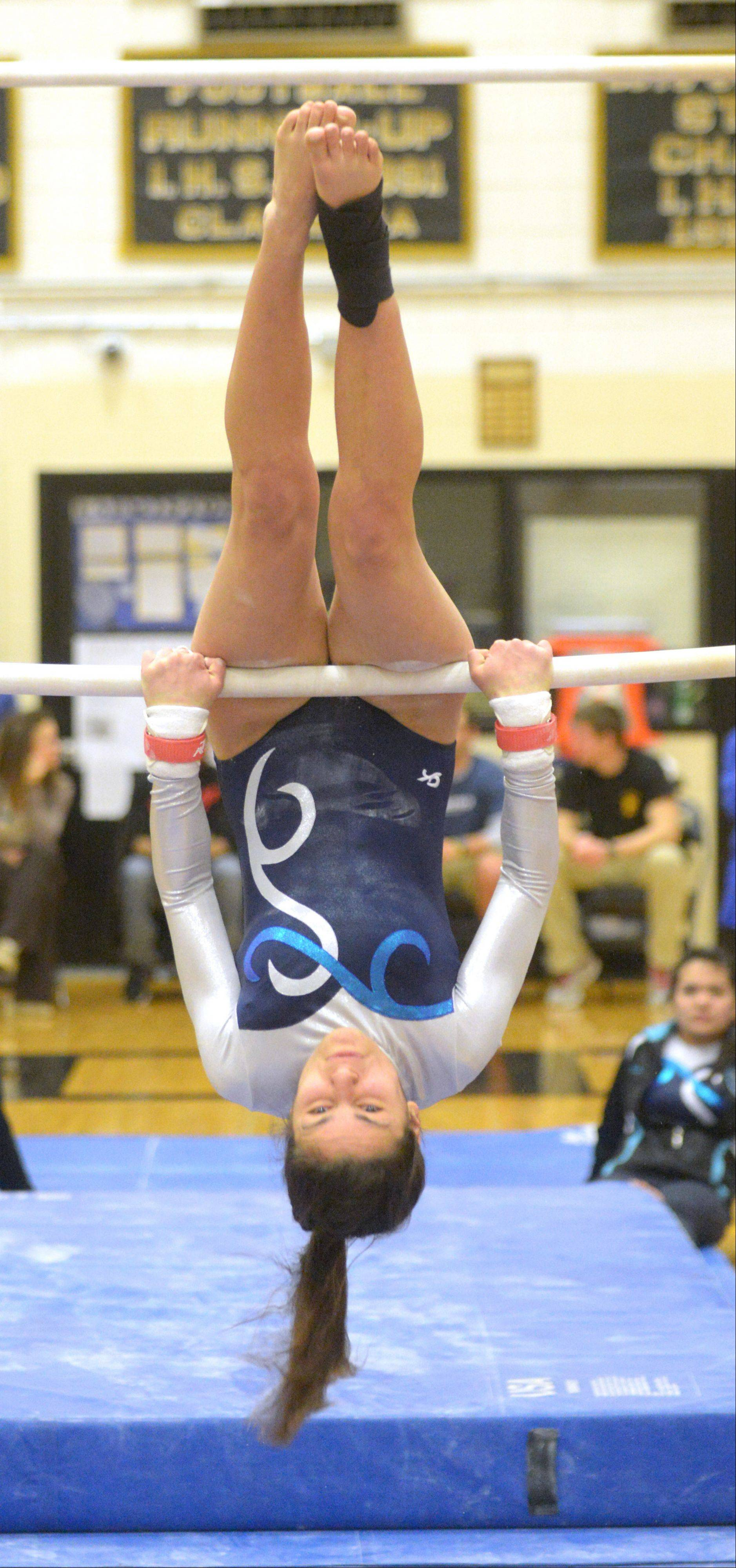 Stefanie Enescu of Willowbrook on the bars during the Glenbard North girls gymnastics regional Wednesday in Carol Stream.