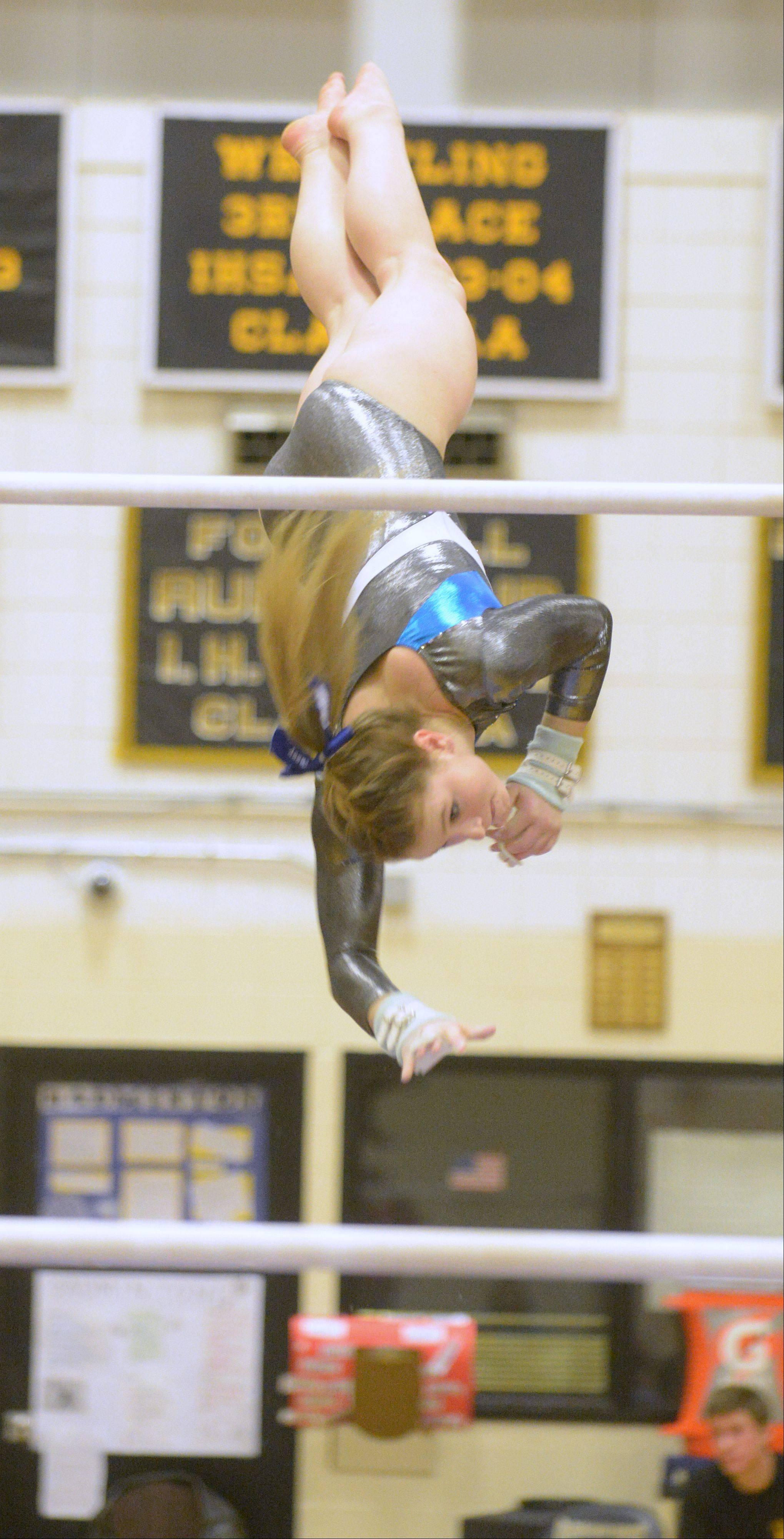 Casey Boksha of Addison Trail on the bars during the Glenbard North girls gymnastics regional Wednesday in Carol Stream.