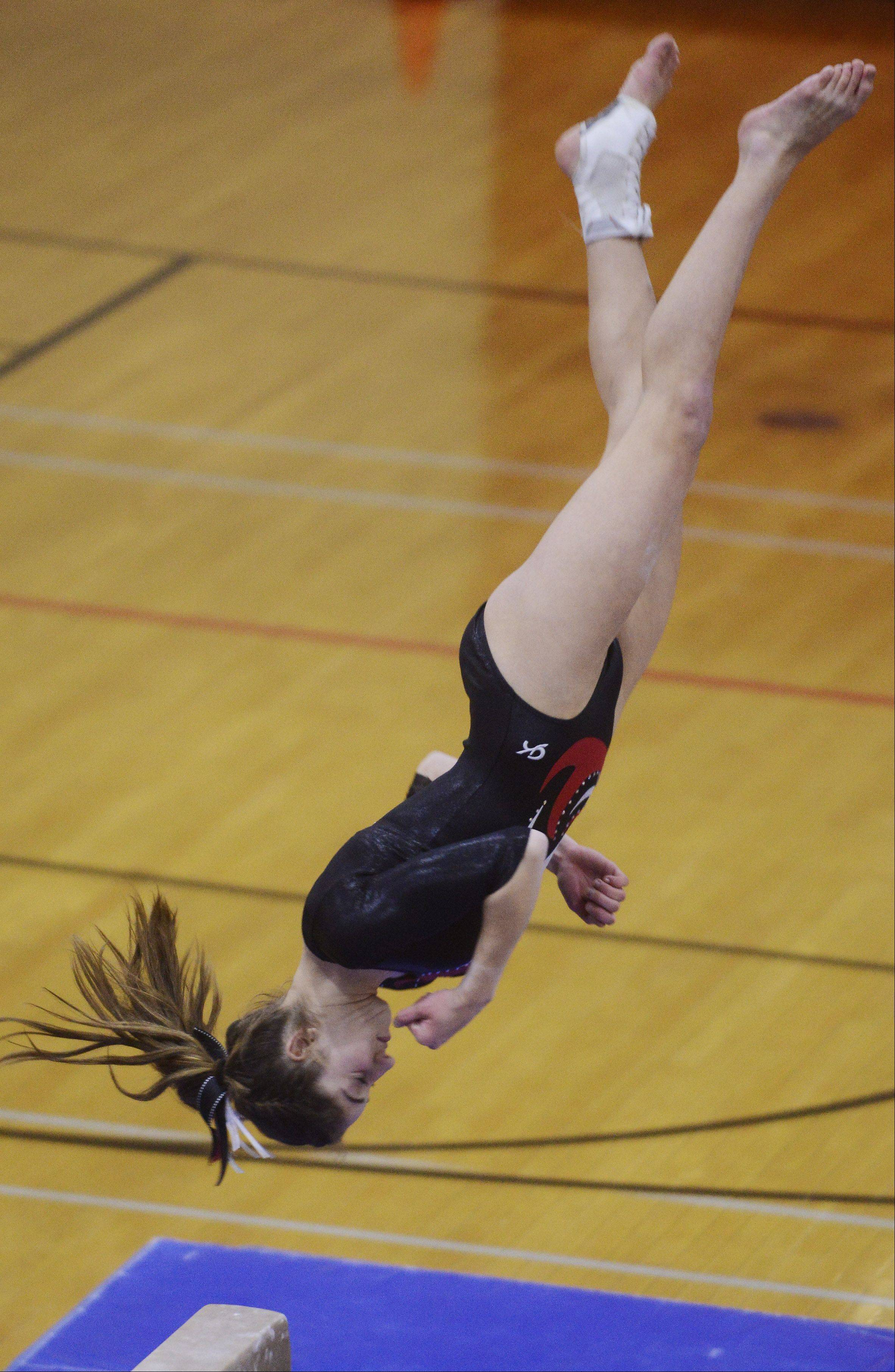 Palatine's Claudia Przystal dismounts from the balance beam during Wednesday's gymnastics regional at Palatine.