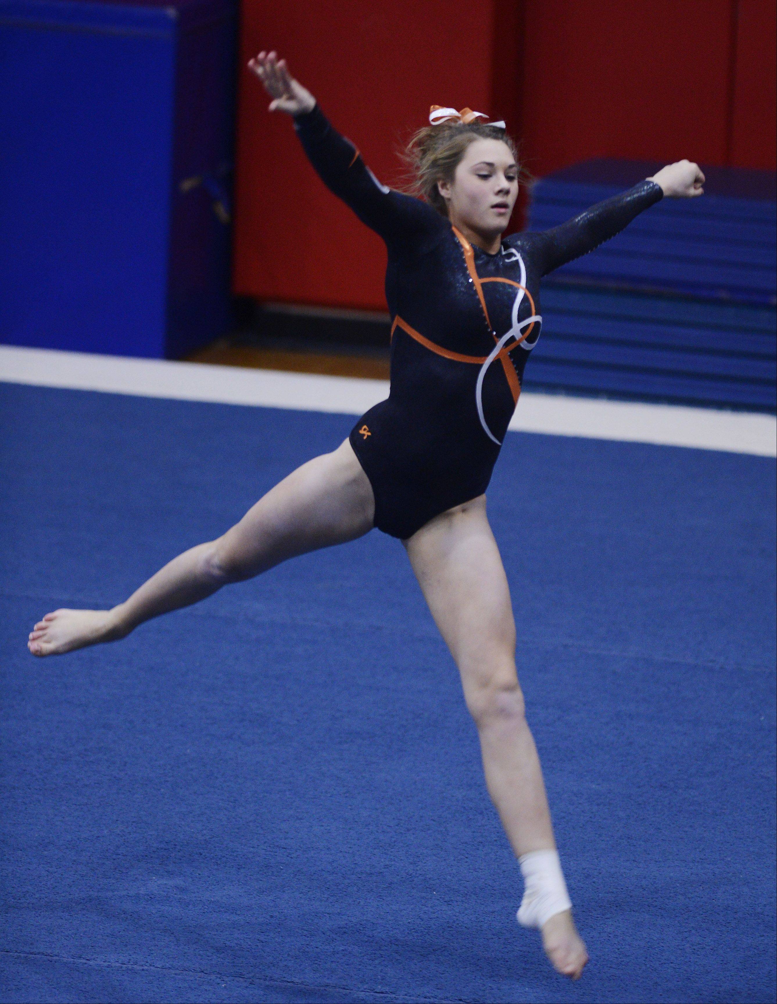 Hersey's Annie Johnson competes on the floor exercise during Wednesday's gymnastics regional at Palatine.