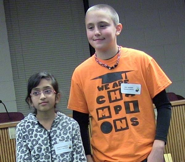 Pragya Kansal, a sixth grader at Frank C. Whiteley School, won the District 15 Spelling Bee, holding off second-place finisher Tim Okonek, a sixth grader at Marion Jordan School.