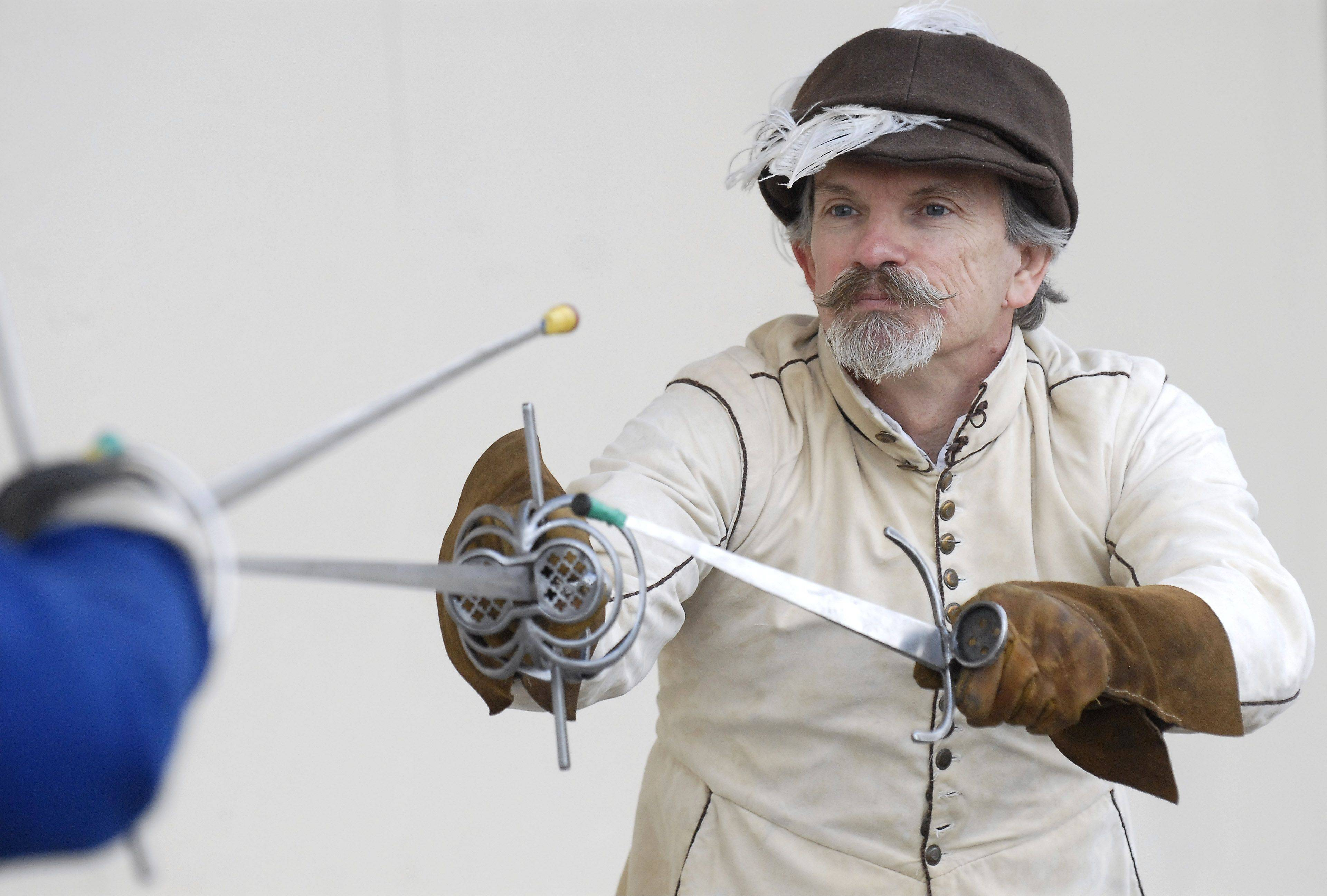 Timothy Lyon of Sycamore teaches Bob Davis of Easton, Pa., tips on Italian rapier sword fighting at last year's Military History Fest at Pheasant Run in St. Charles.