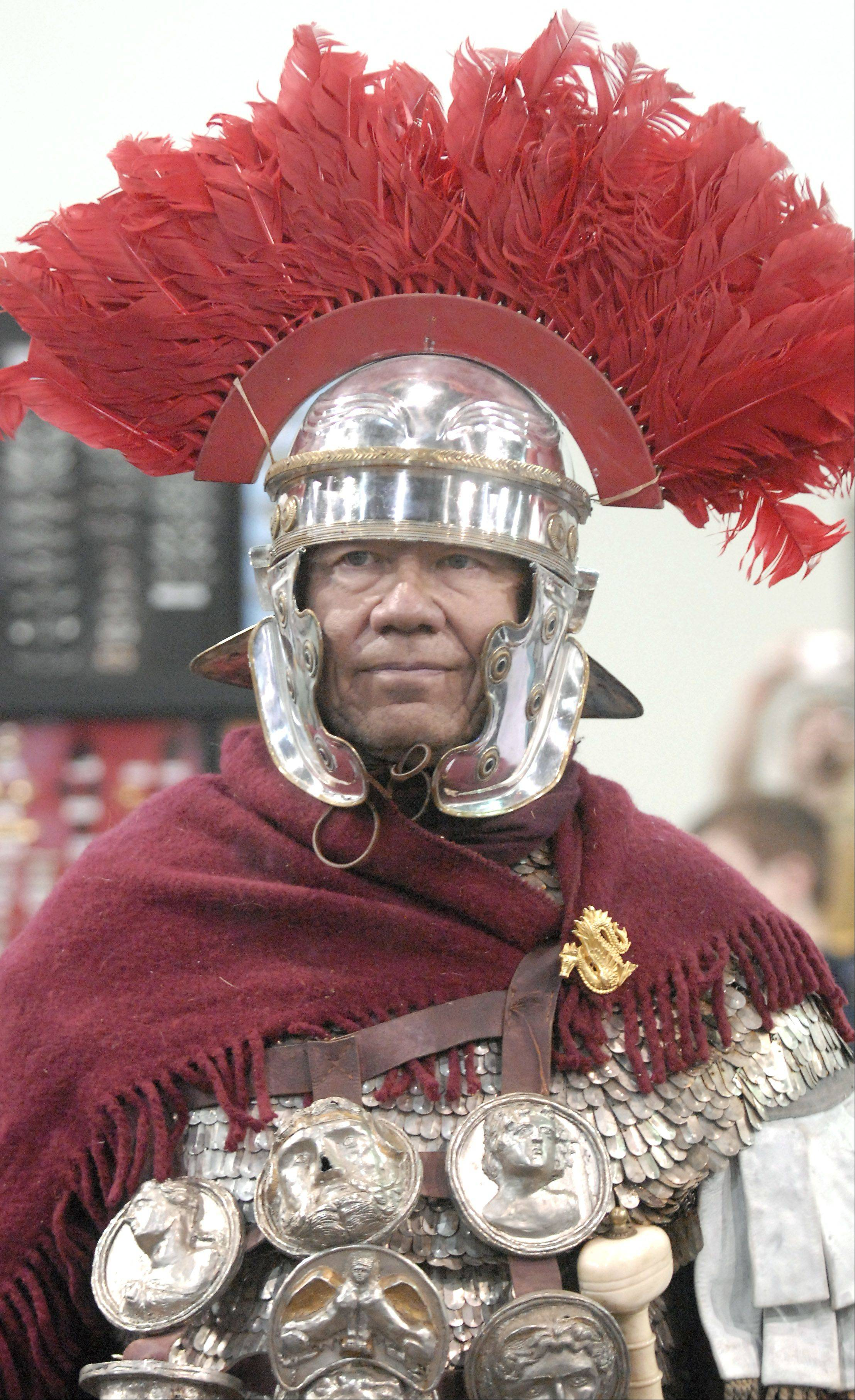 "Dan Peterson of Fort Campbell, Ky., wears Roman-style military gear, all of which he made himself, at last year's Military History Fest in St. Charles. Peterson wrote a book about the Roman military 20 years ago titled ""The Roman Legions."" He has been re-enacting this time period for 30 years. He is also the director of the Pratt Museum in Fort Campbell."
