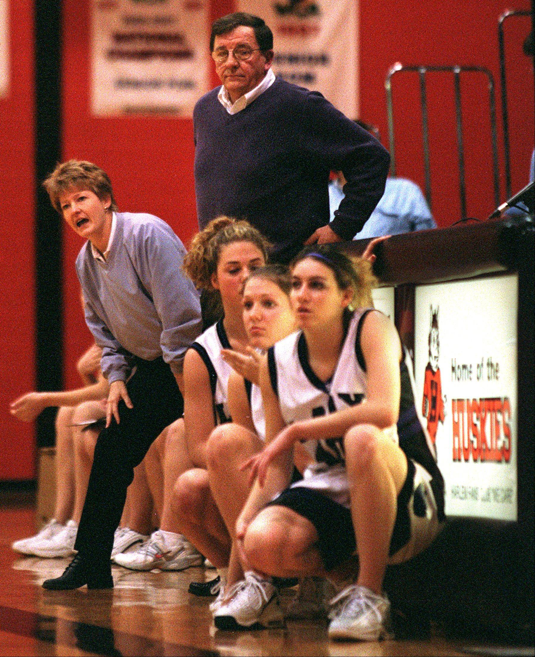 Former Hampshire girls basketball coaches Milt Awe and Sue Ellett guide the Whip-Purs during the 2002 Harlem Christmas Tournament. Later that season, Hampshire brought home its first state trophy in basketball when the Whip-Pur girls finished third in Class A.