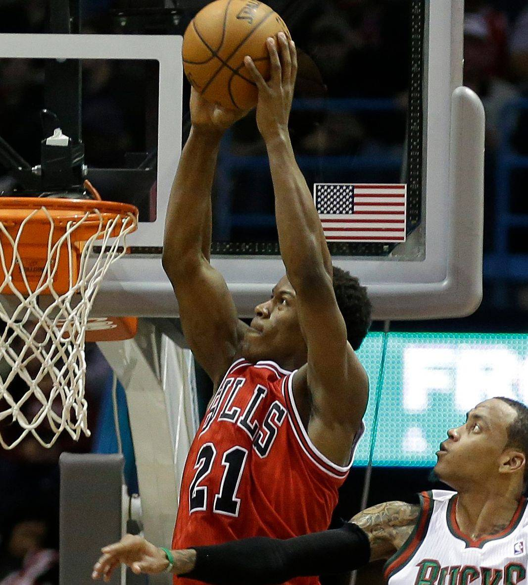 Jimmy Butler dunks against the Bucks� Monta Ellis on Wednesday. In the Bulls� last two games, Butler has been the first sub off the bench in the third quarter.