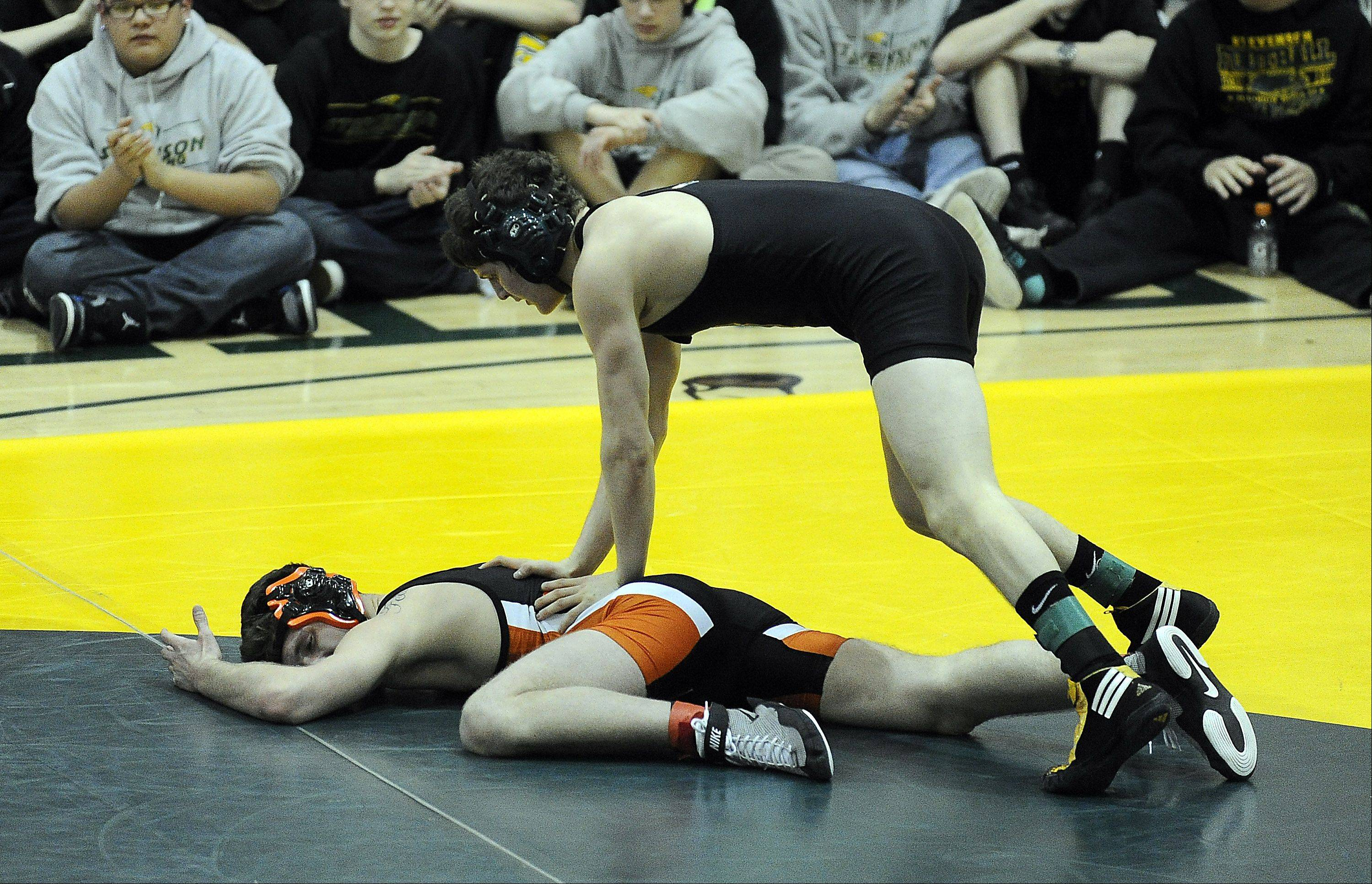 Stevenson�s Justin Weber stands over Austin Pettinato of Libertyville in the 145-pound championship match during last week�s North Suburban Conference tournament at Stevenson.