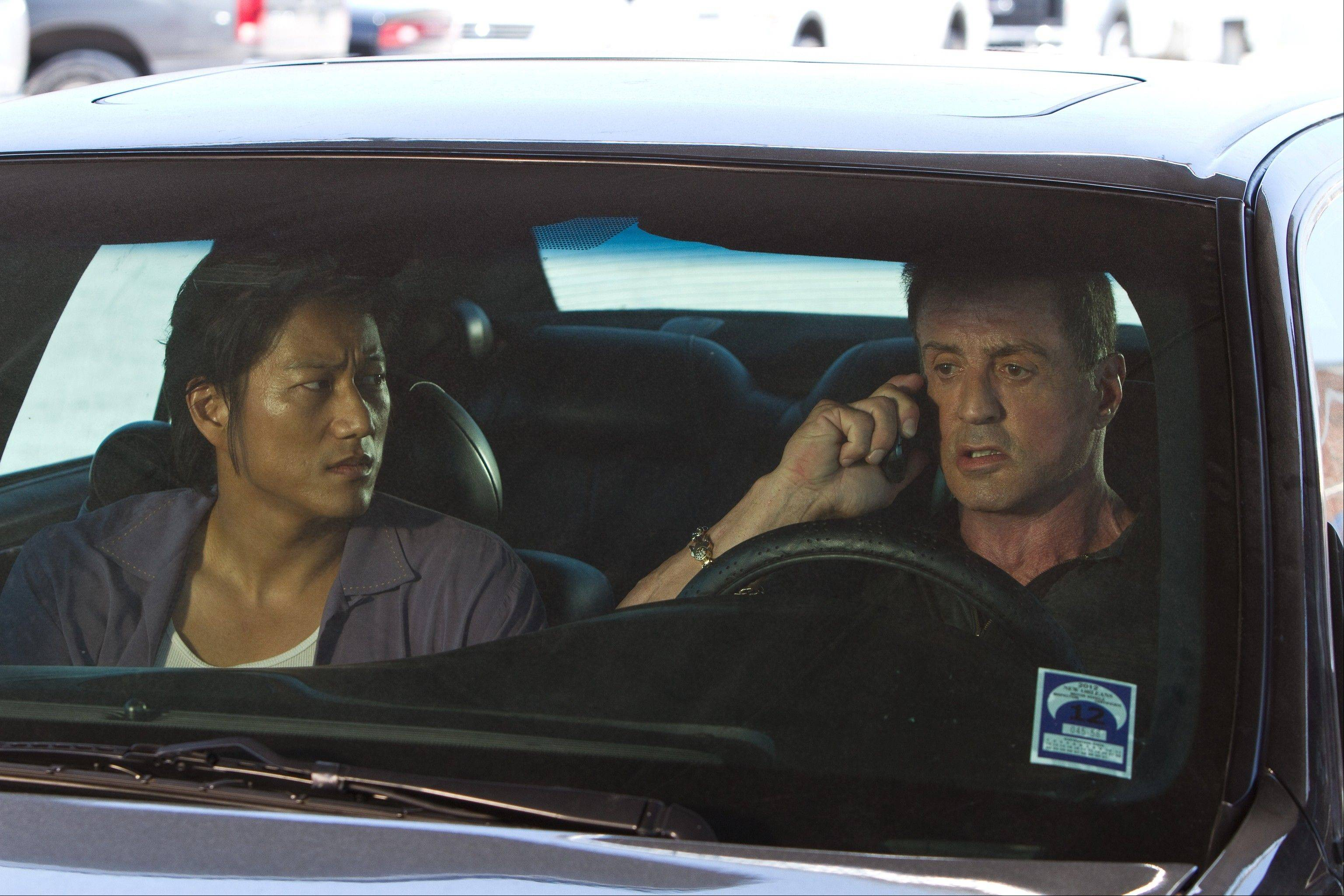 "A cop (Sung Kang) joins with a hit man (Sylvester Stallone) to catch some killers in Walter Hill's arrested action drama ""Bullet to the Head."""