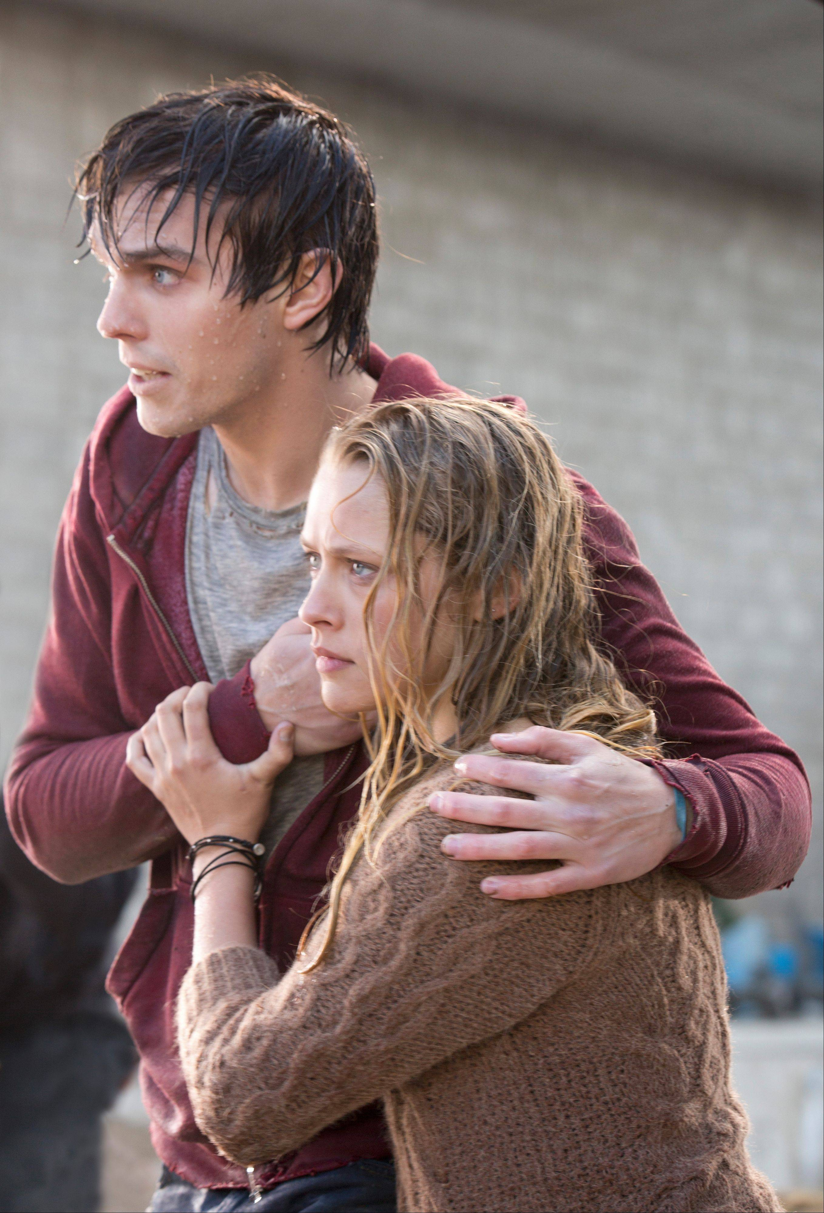 "A zombie named R (Nicholas Hoult) saves a human girl (Teresa Palmer) from becoming a snack in Jonathan Levine's surprisingly sweet undead romance ""Warm Bodies."""
