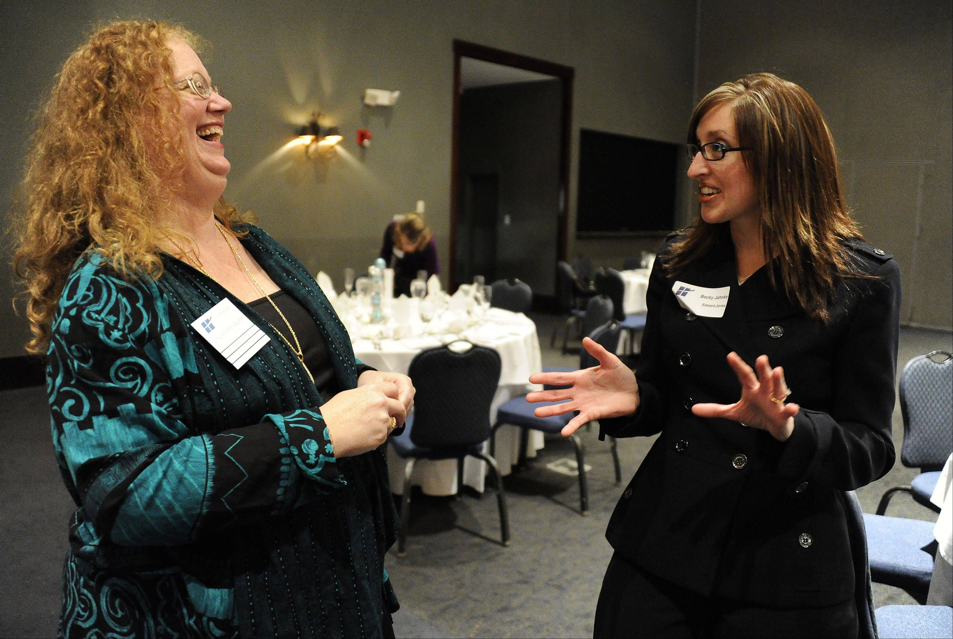 Volunteer of the Year nominees Linda Dressler, left, from ACM Reality in Hoffman Estates and Becky Jahnke of the Edward Jones Group share a laugh at the second annual Celebration of Excellence in Hoffman Estates on Thursday. Jahnke went on to win the Volunteer of the Year award later in the night.