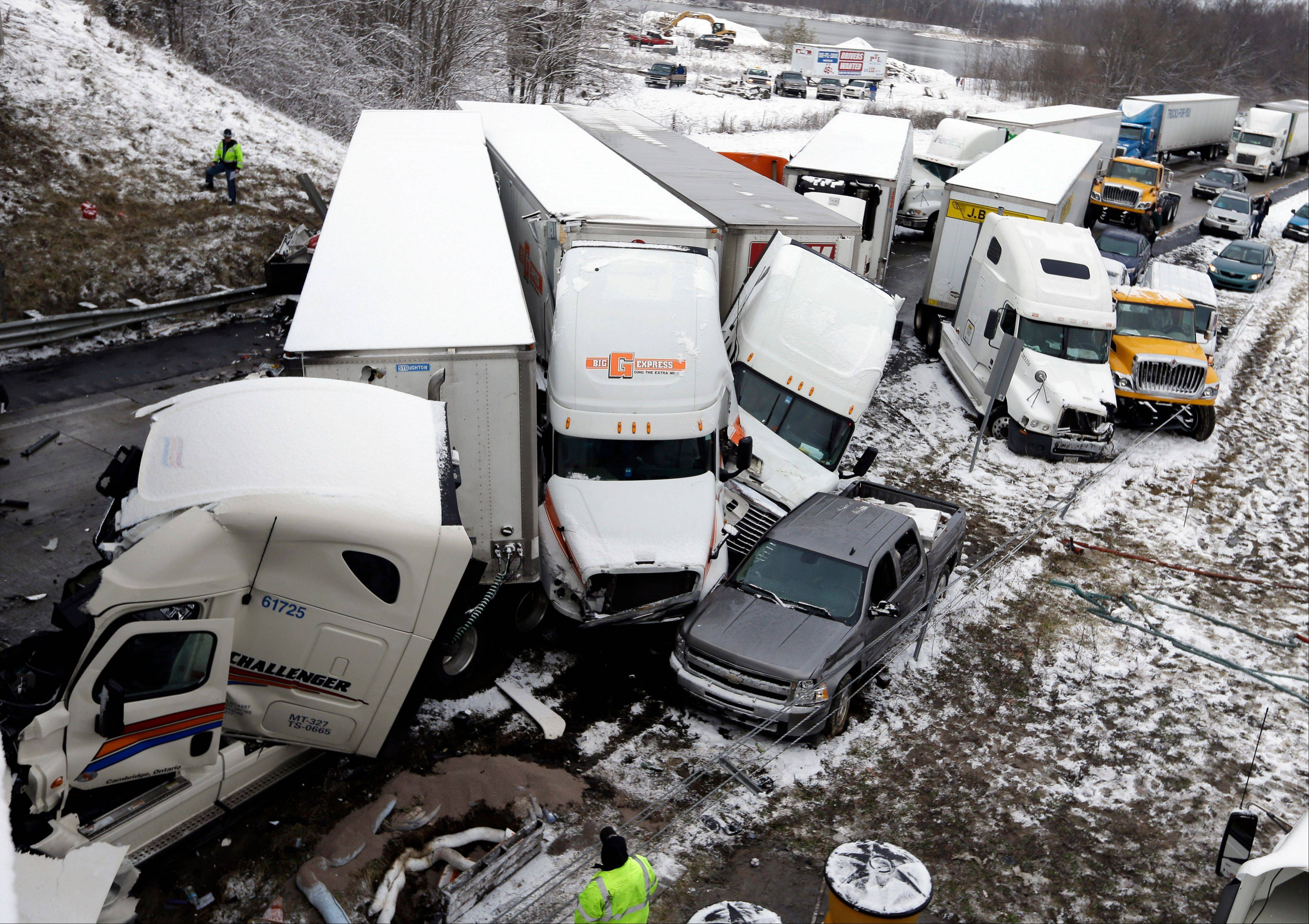 Police and emergency personal work the scene of a pileup involving more than 30 vehicles Thursday on Interstate 70 in Plainfield, Ind. The crash closed the interstate in both directions.
