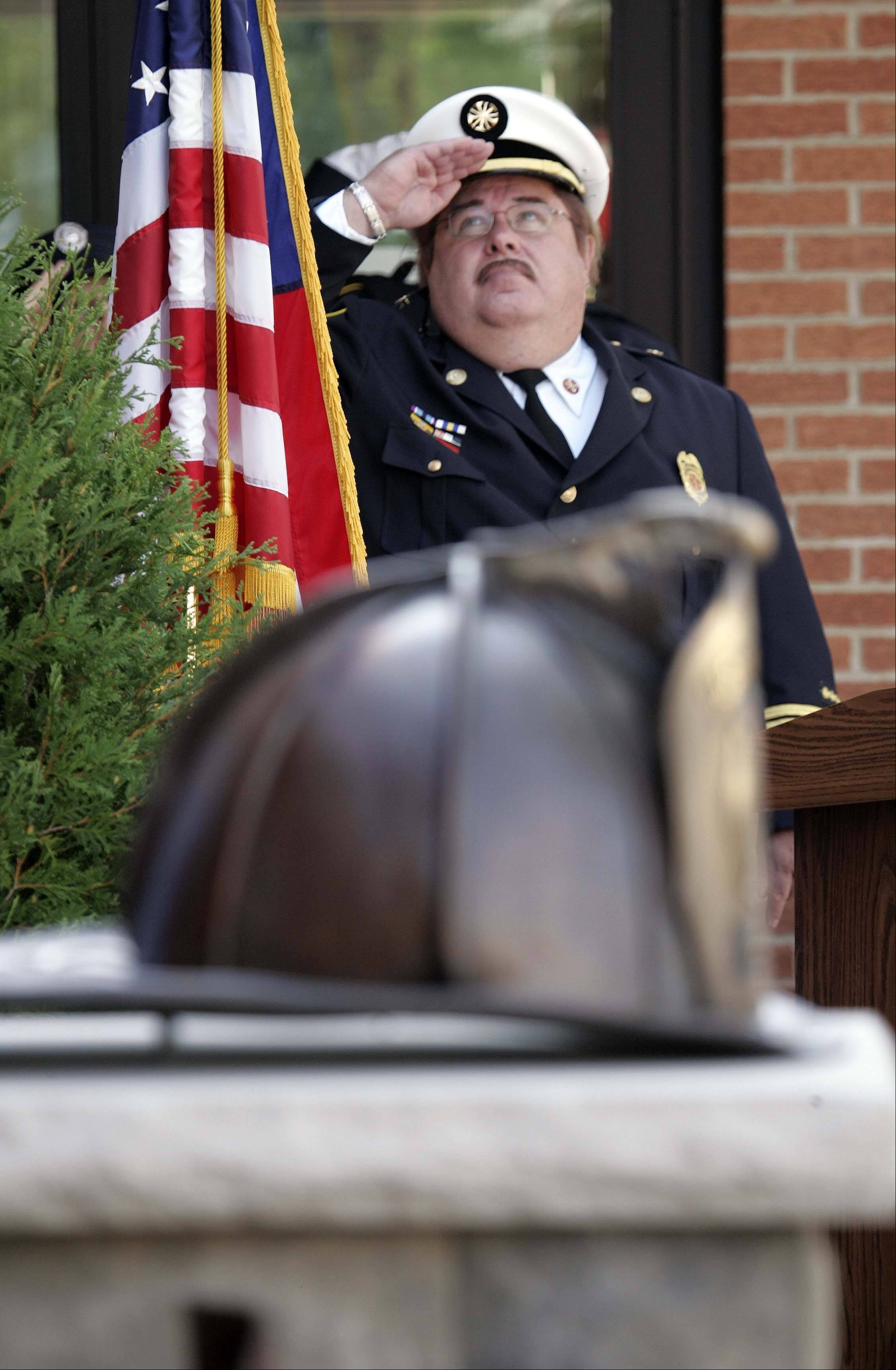 Carpentersville Fire Chief John Schuldt took part in the department's dedication of its firefighter and Sept. 11 memorial in September 2011.