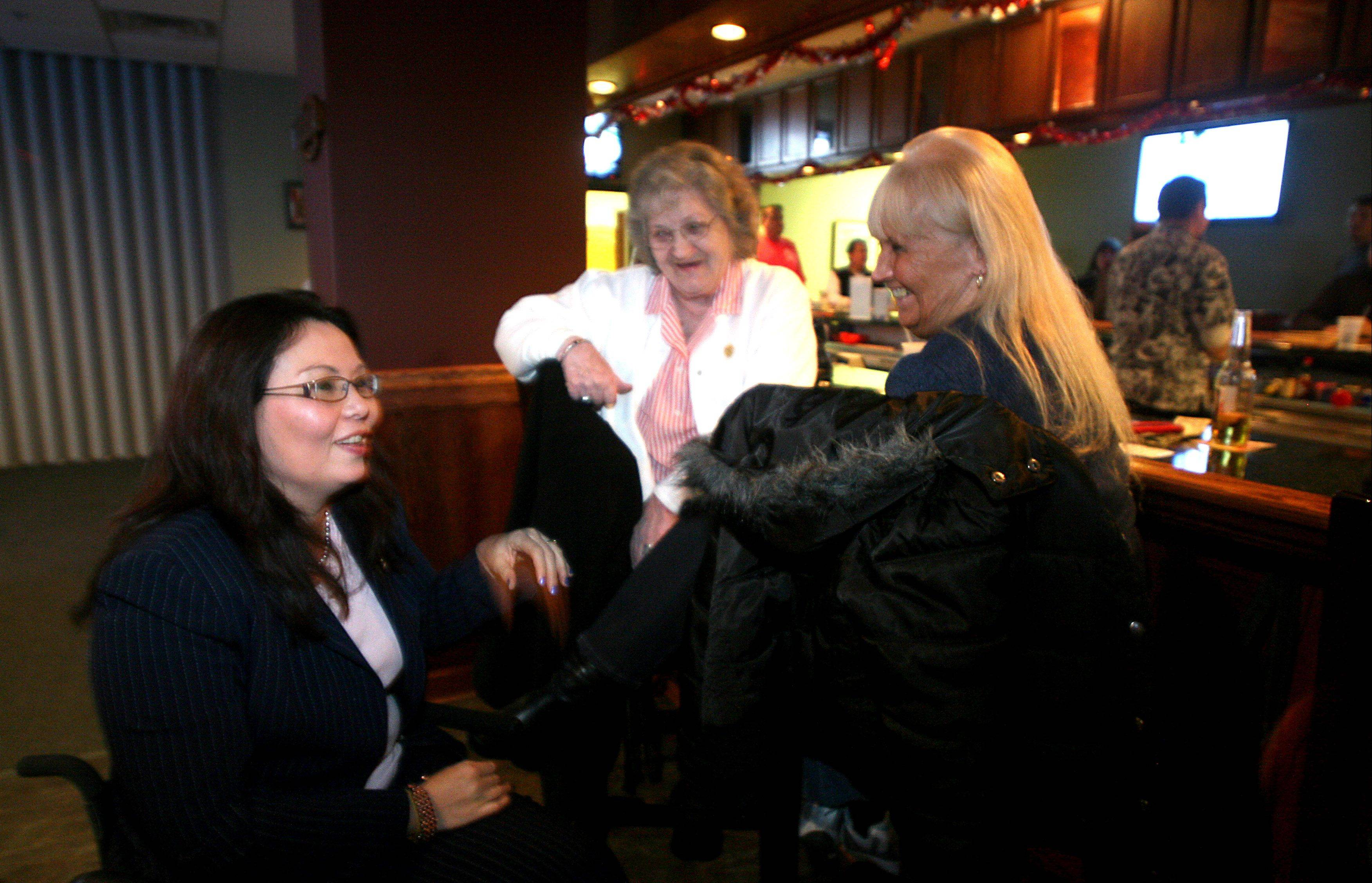 U.S. Rep. Tammy Duckworth speaks with Mary Werrbach, center, and Norma Linehan, right, both of Elgin, at Elgin VFW Post 1307 on Wednesday night. Duckworth contributed to efforts to donate supplies for wounded soldiers overseas.