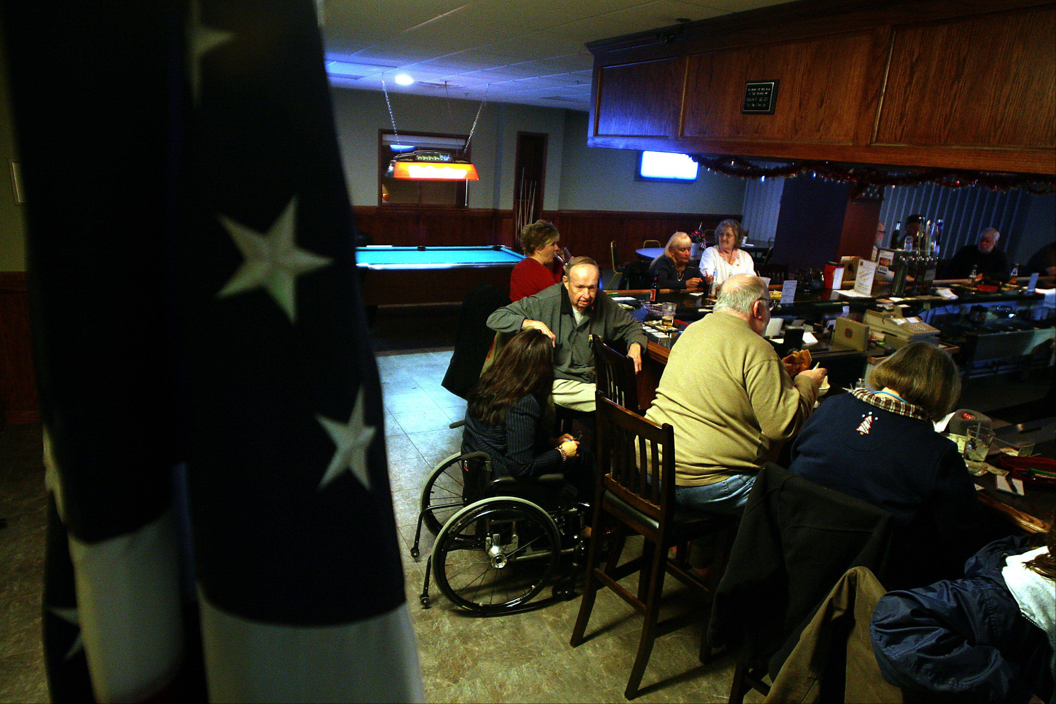 U.S. Rep. Tammy Duckworth visited Elgin VFW Post 1307 on Wednesday night to contribute to efforts to donate supplies for wounded soldiers overseas. Here, she talks with Elgin veteran Walt Telford.