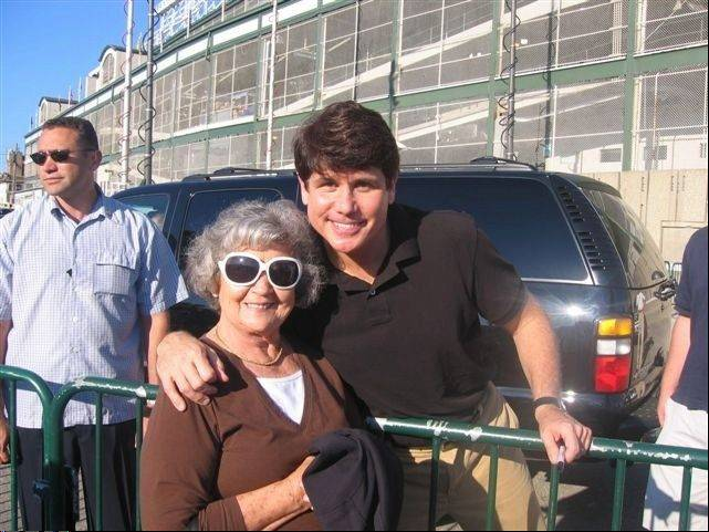 Since this photo was taken outside Wrigley Field after a Cubs game, my mom has benefitted from some life-improving surgeries and just became the longest-living woman in her family's history by celebrating her 86th birthday. Then-Gov. Rod Blagojevich has not fared as well.
