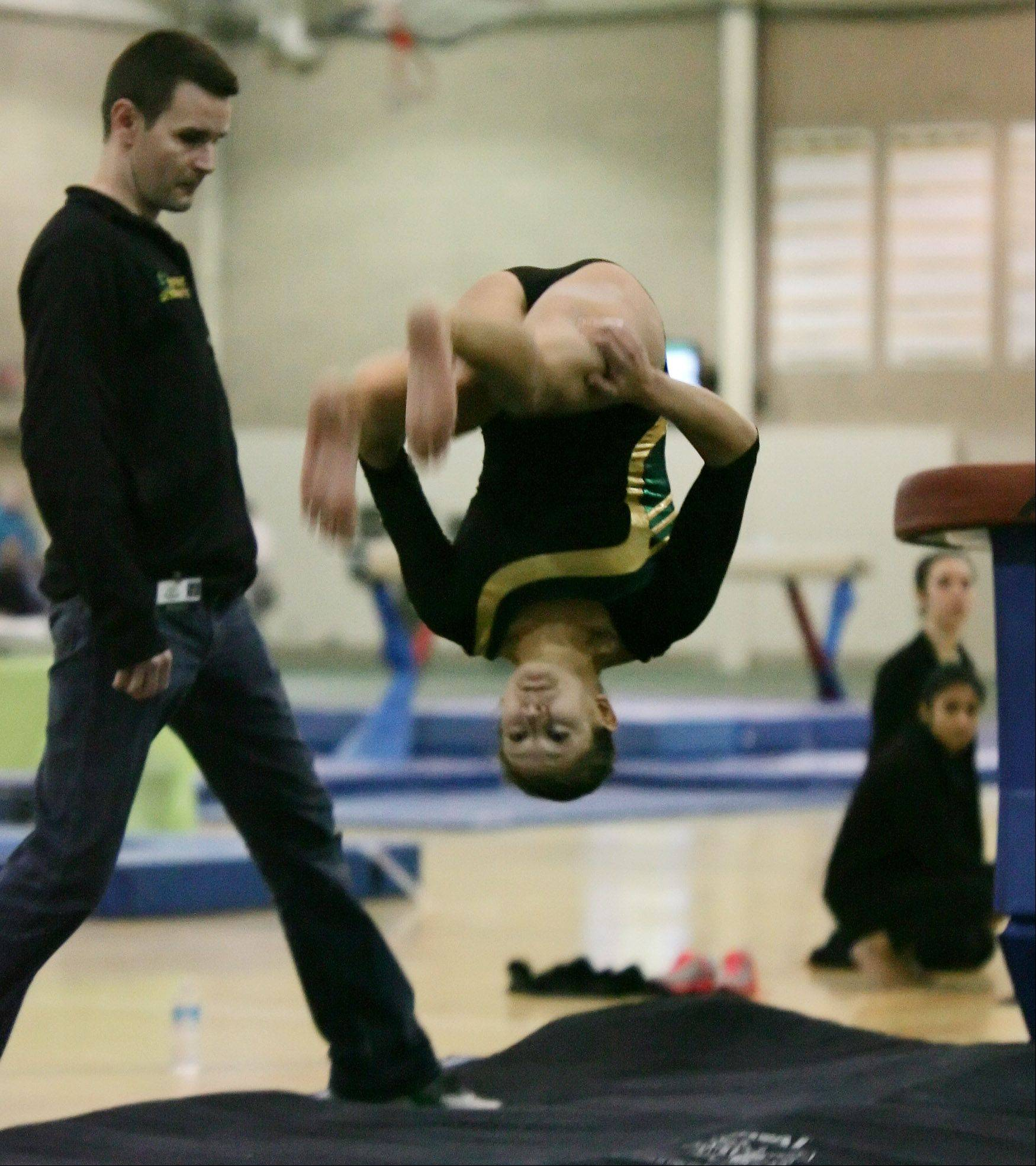 Stevenson gymnast Becca Feltman-Frank rotates during her vault in the Stevenson regional on Thursday. Feltman-Frank was spotted by assistant coach John Deppong.