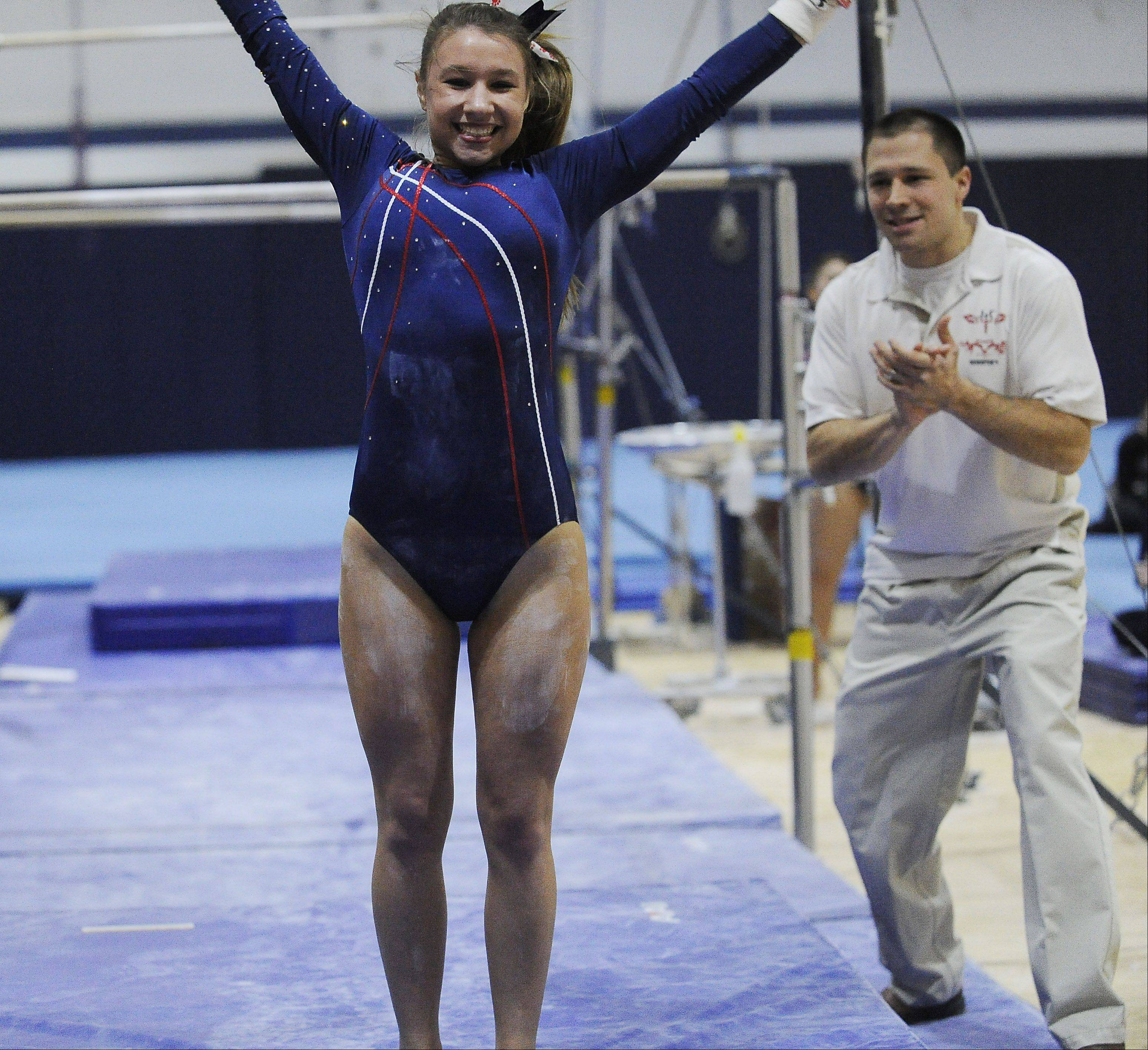 Conant's Sarah Starzynski is happy with her performance on the uneven parallel bars at Thursday's Conant regional.