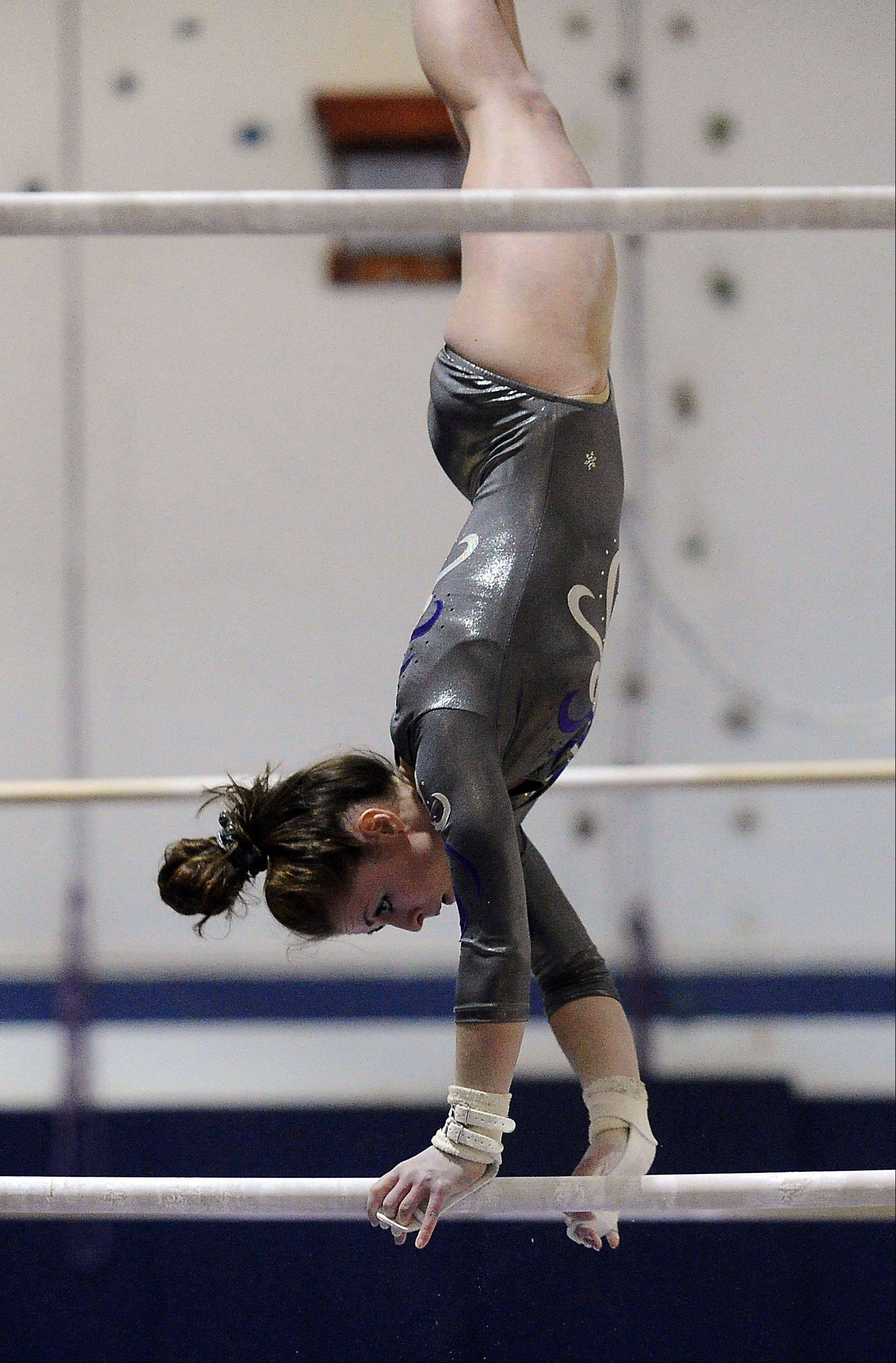 St. Edward's Abby Madden performs her uneven parallel bars routine at Thursday's Conant regional.