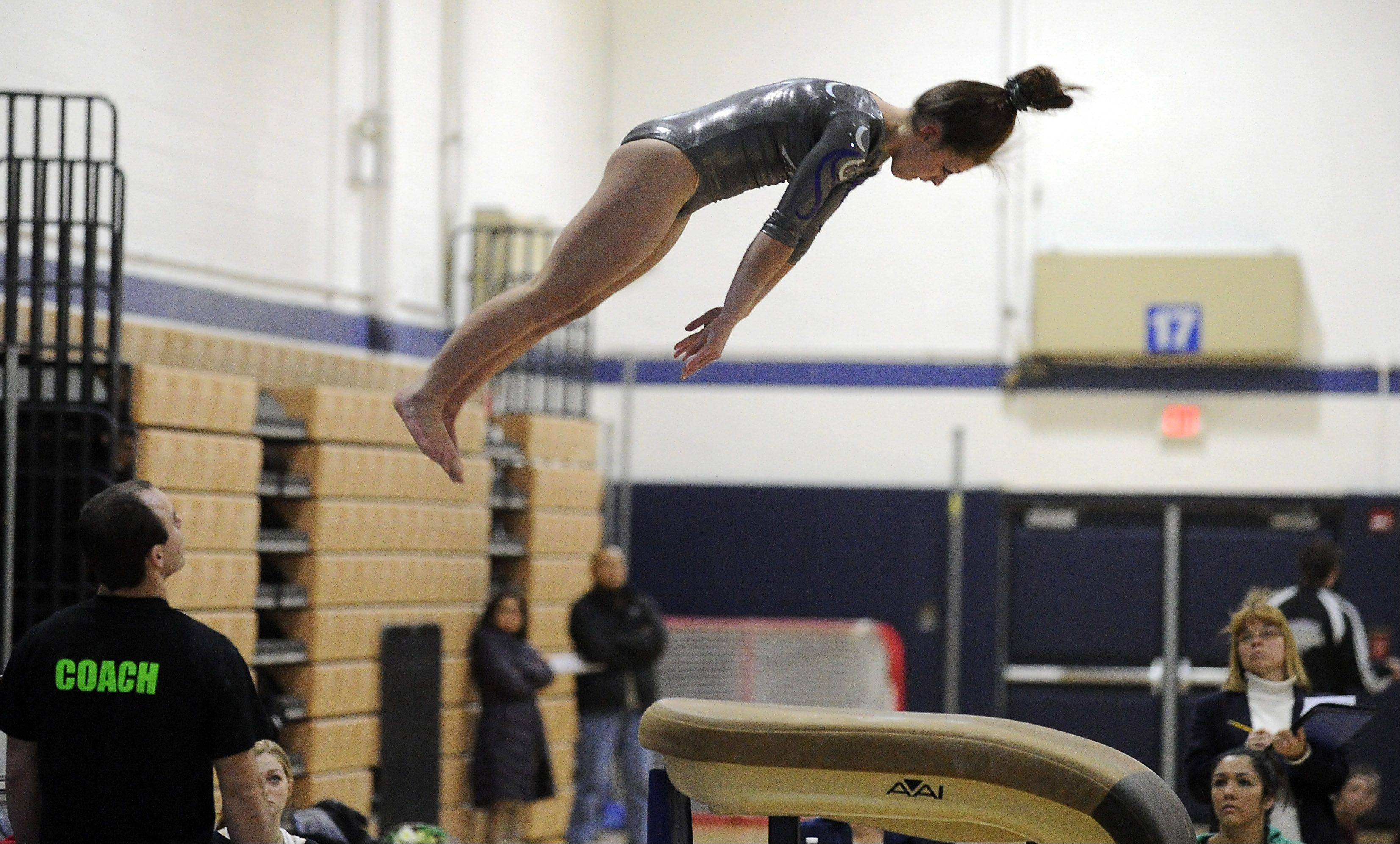 Mark Welsh/mwelsh@dailyherald.comSt. Edward's Abby Madden performs her vault routine at Thursday's Conant regional.